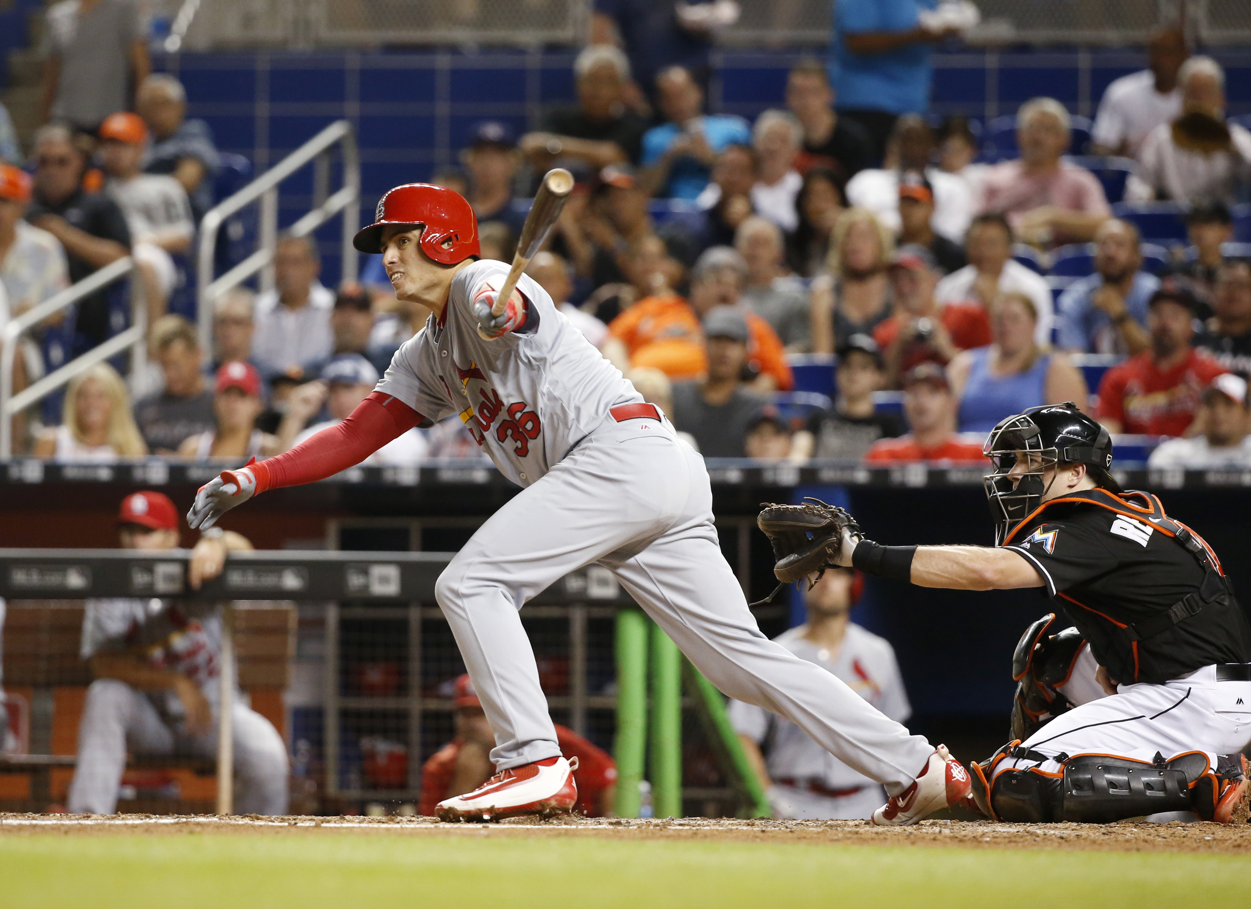 St. Louis Cardinals' Aledmys Diaz watches his RBI double during the fifth inning of a baseball game against the Miami Marlins, Thursday, July 28, 2016, in Miami. (AP Photo/Wilfredo Lee)