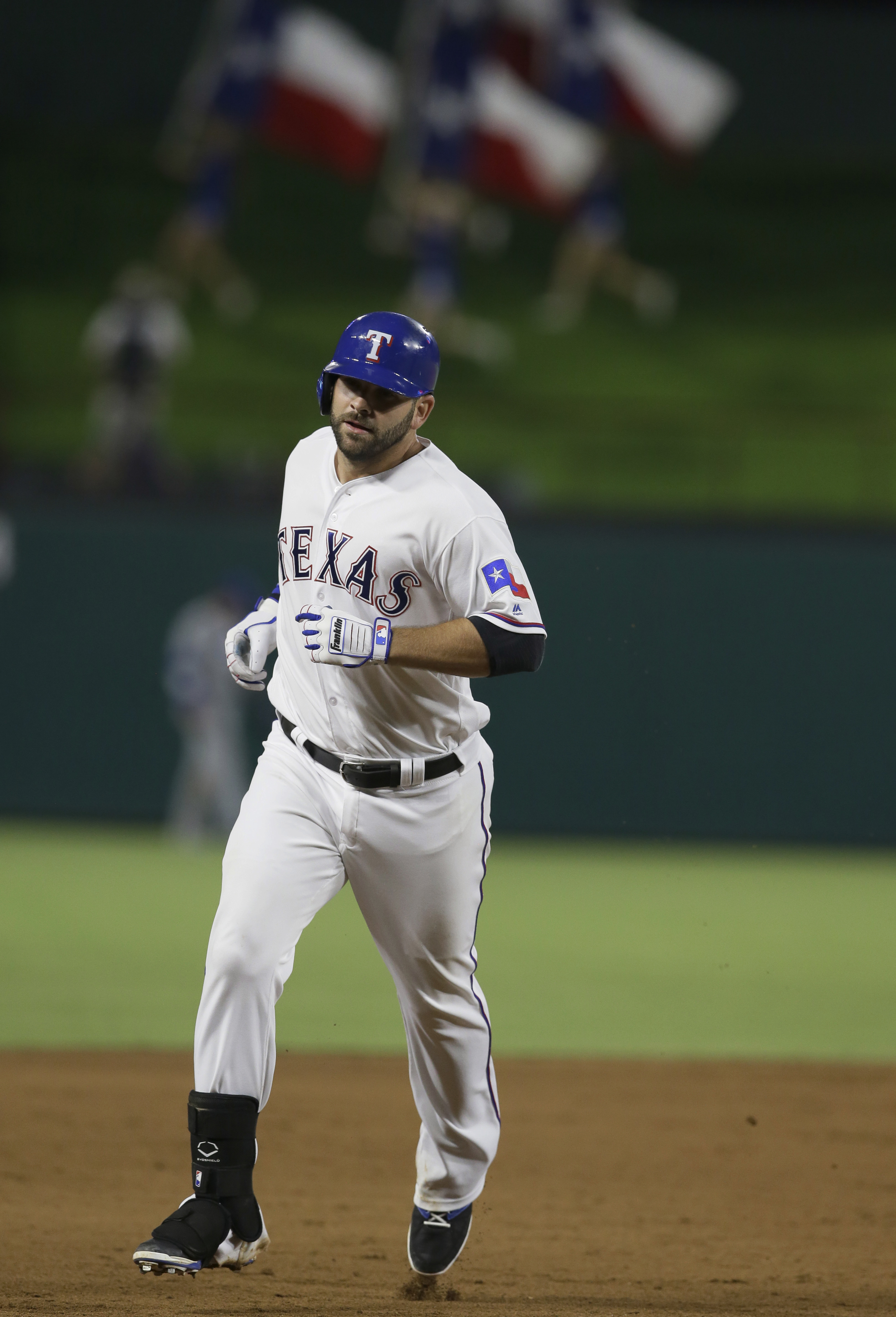 Texas Rangers' Mitch Moreland runs the base after his solo home run during the eighth inning of a baseball game against the Kansas City Royals in Arlington, Texas, Thursday, July 28, 2016. The Rangers won 3-2. (AP Photo/LM Otero)
