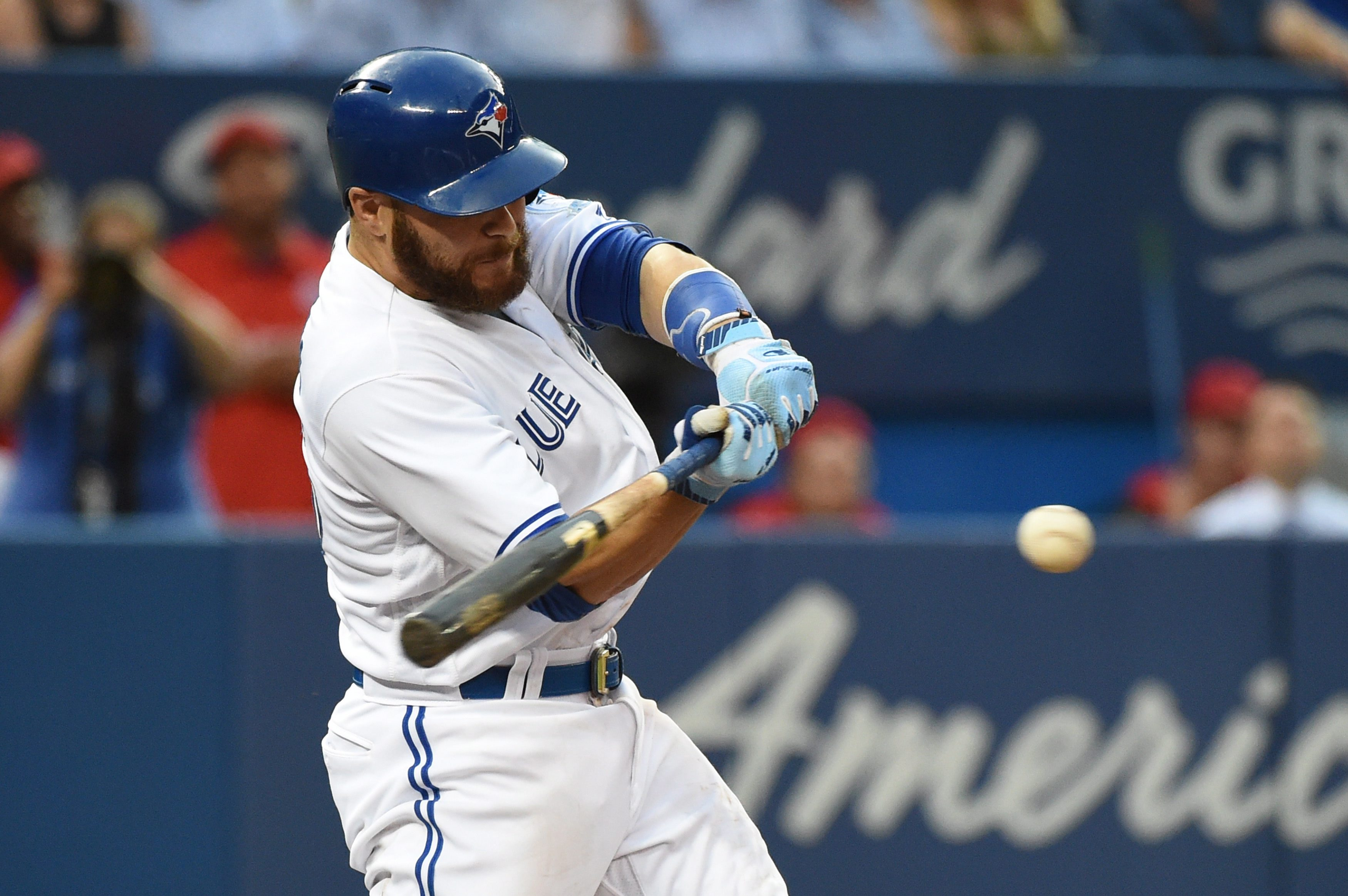 Toronto Blue Jays' Russell Martin hits an RBI single against the Baltimore Orioles during the third inning of a baseball game Friday, July 29, 2016, in Toronto. (Jon Blacker/The Canadian Press via AP)