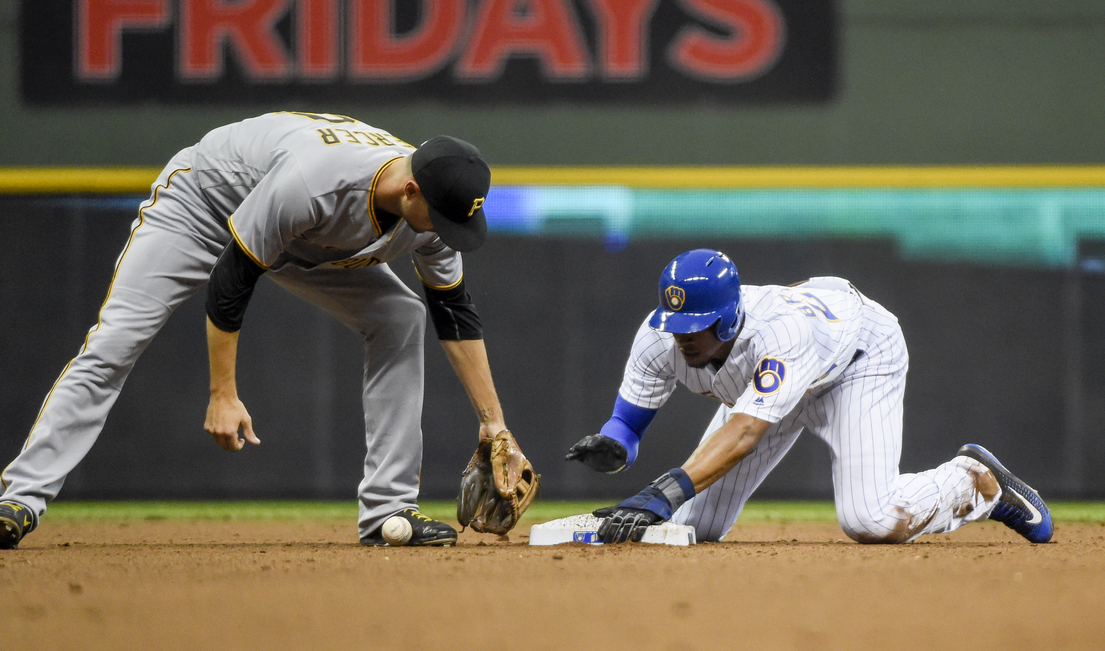 Milwaukee Brewers' Keon Broxton, right, steals second base as Pittsburgh Pirates shortstop Jordy Mercer, left, fields the ball during the fourth inning of a baseball game Friday, July 29, 2016, in Milwaukee. (AP Photo/Benny Sieu)
