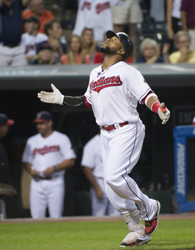 Cleveland Indians' Carlos Santana celebrates after hitting a home run off Oakland Athletics starter Kendall Graveman during the sixth inning of a baseball game in Cleveland, Friday, July 29, 2016. (AP Photo/Phil Long)