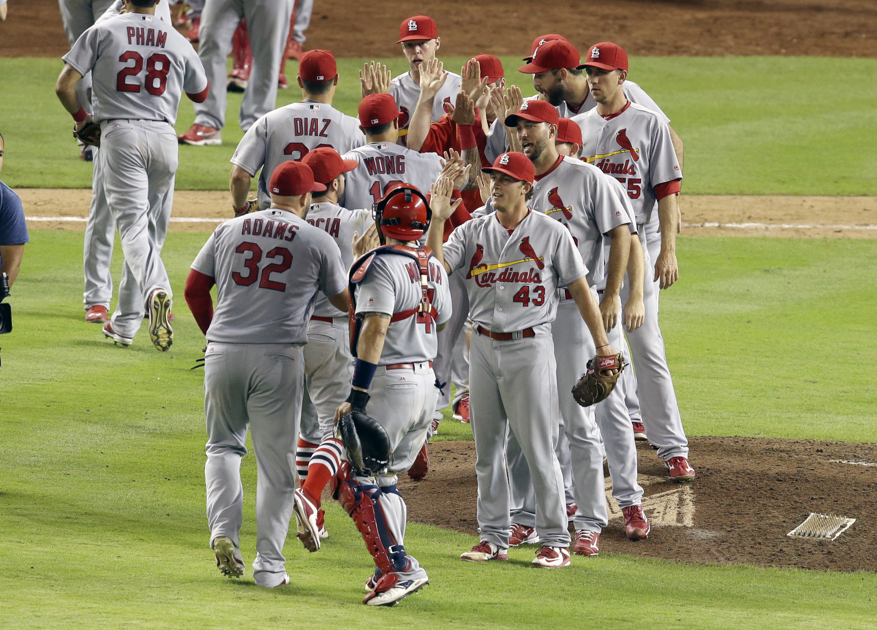 St. Louis Cardinals relief pitcher Seth Maness (43) high-fives teammates after they defeated the Miami Marlins in a baseball game, Friday, July 29, 2016, in Miami. (AP Photo/Lynne Sladky)