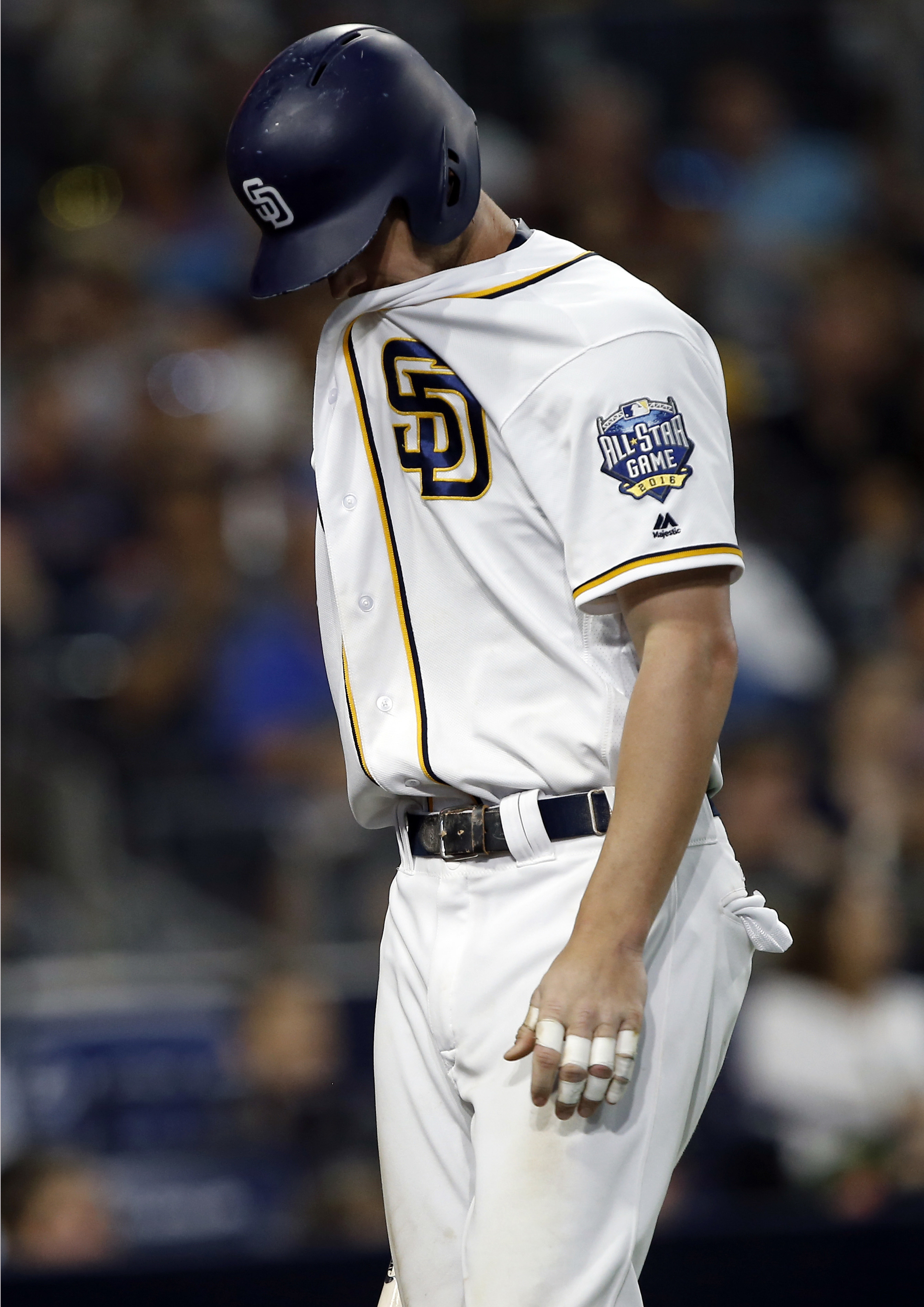 San Diego Padres' Wil Myers walks back to the dugout after striking out during the eighth inning of a baseball game Cincinnati Reds in San Diego, Saturday, July 30, 2016. (AP Photo/Alex Gallardo)