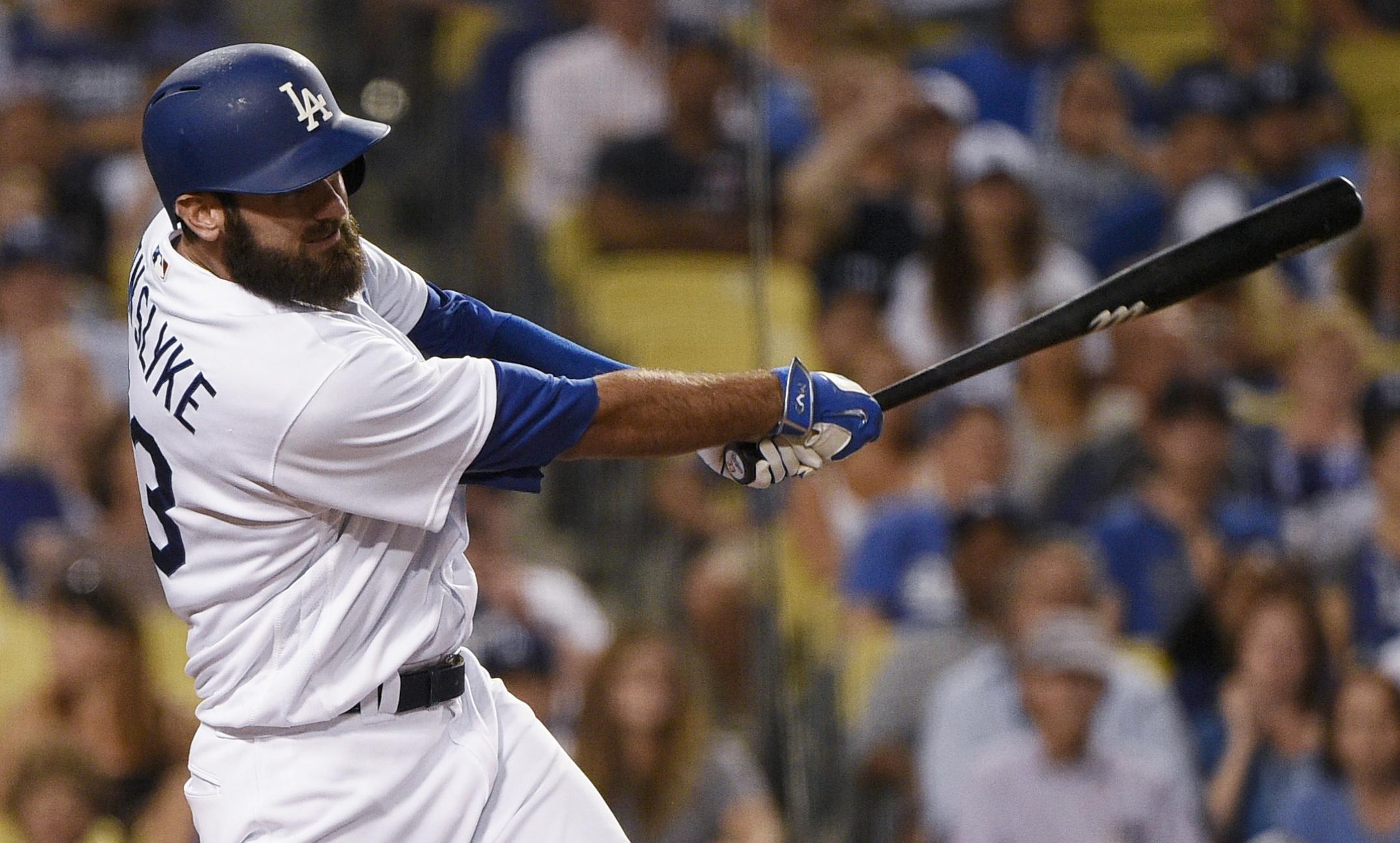 Los Angeles Dodgers' Scott Van Slyke hits an RBI single during the seventh inning of a baseball game against the Arizona Diamondbacks in Los Angeles, Saturday, July 30, 2016. (AP Photo/Kelvin Kuo)