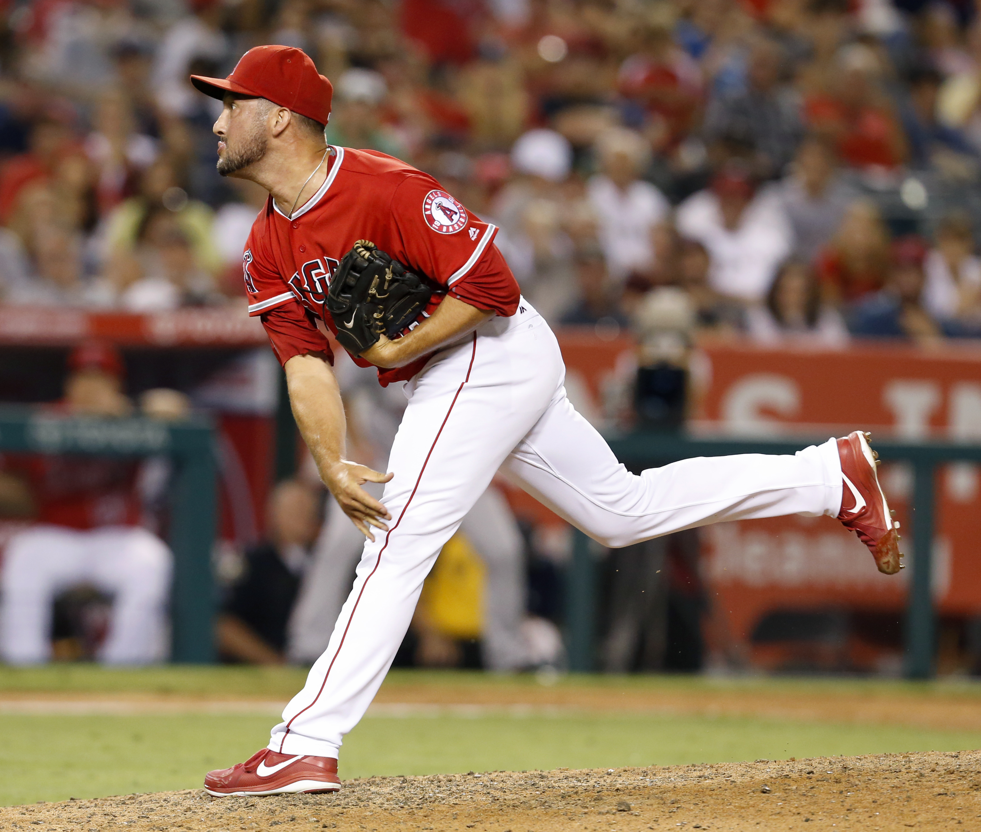 Los Angeles Angels reliever Huston Street watches a pitch during the ninth inning of a baseball game against the Boston Red Sox in Anaheim, Calif., Saturday, July 30, 2016. The Angels won 5-2. (AP Photo/Christine Cotter)