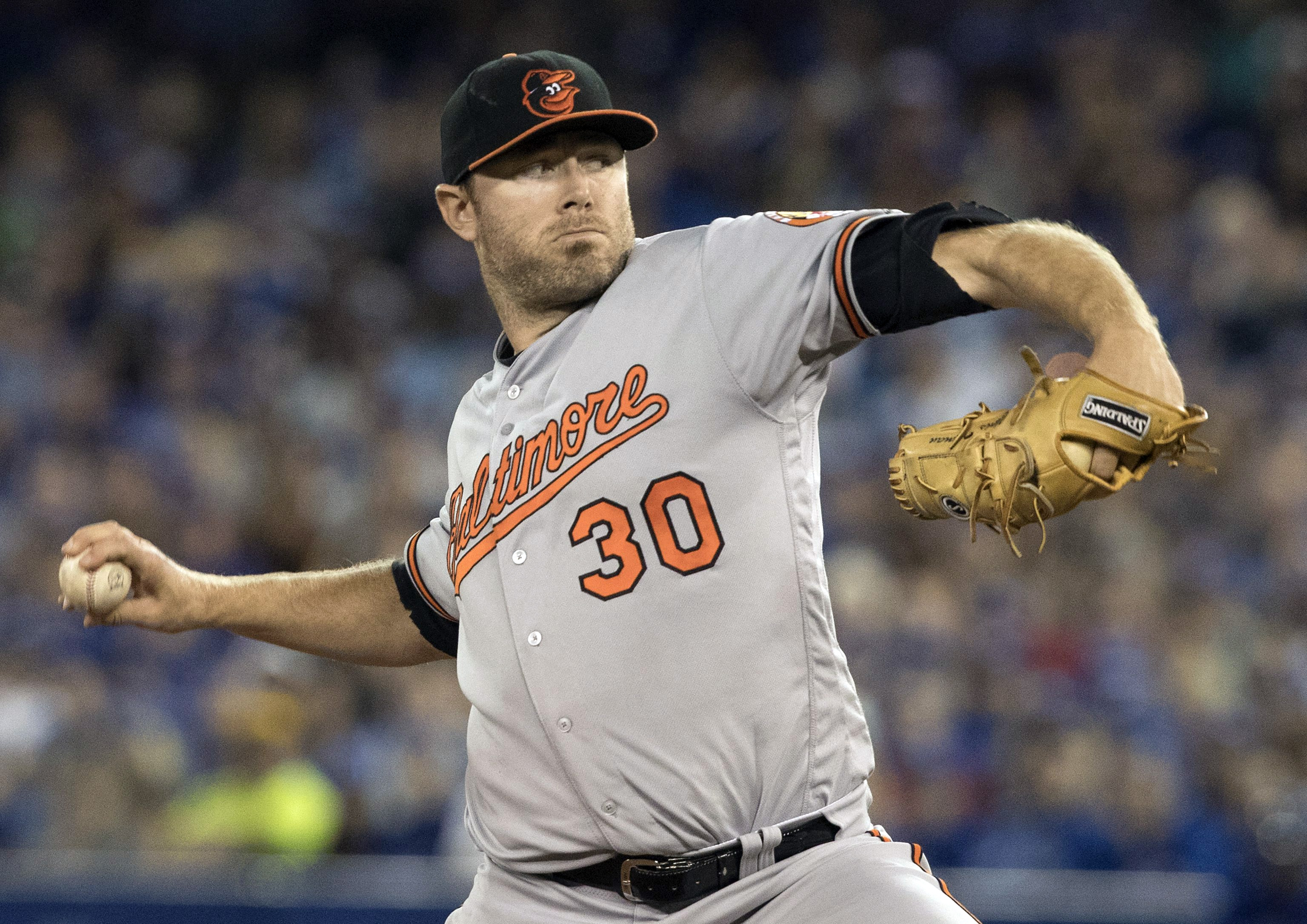 Baltimore Orioles starting pitcher Chris Tillman throws against the Toronto Blue Jays during the first inning of a baseball game in Toronto, Sunday, July 31, 2016. (Fred Thornhill/The Canadian Press via AP)