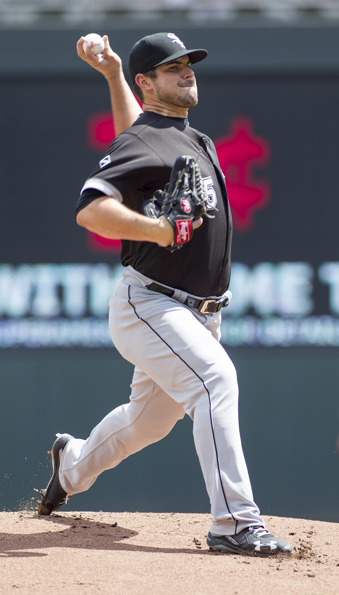 Chicago White Sox starting pitcher Carlos Rodon delivers during the first inning of a baseball game against the Minnesota Twins, Sunday, July 31, 2016, in Minneapolis. (AP Photo/Paul Battaglia)