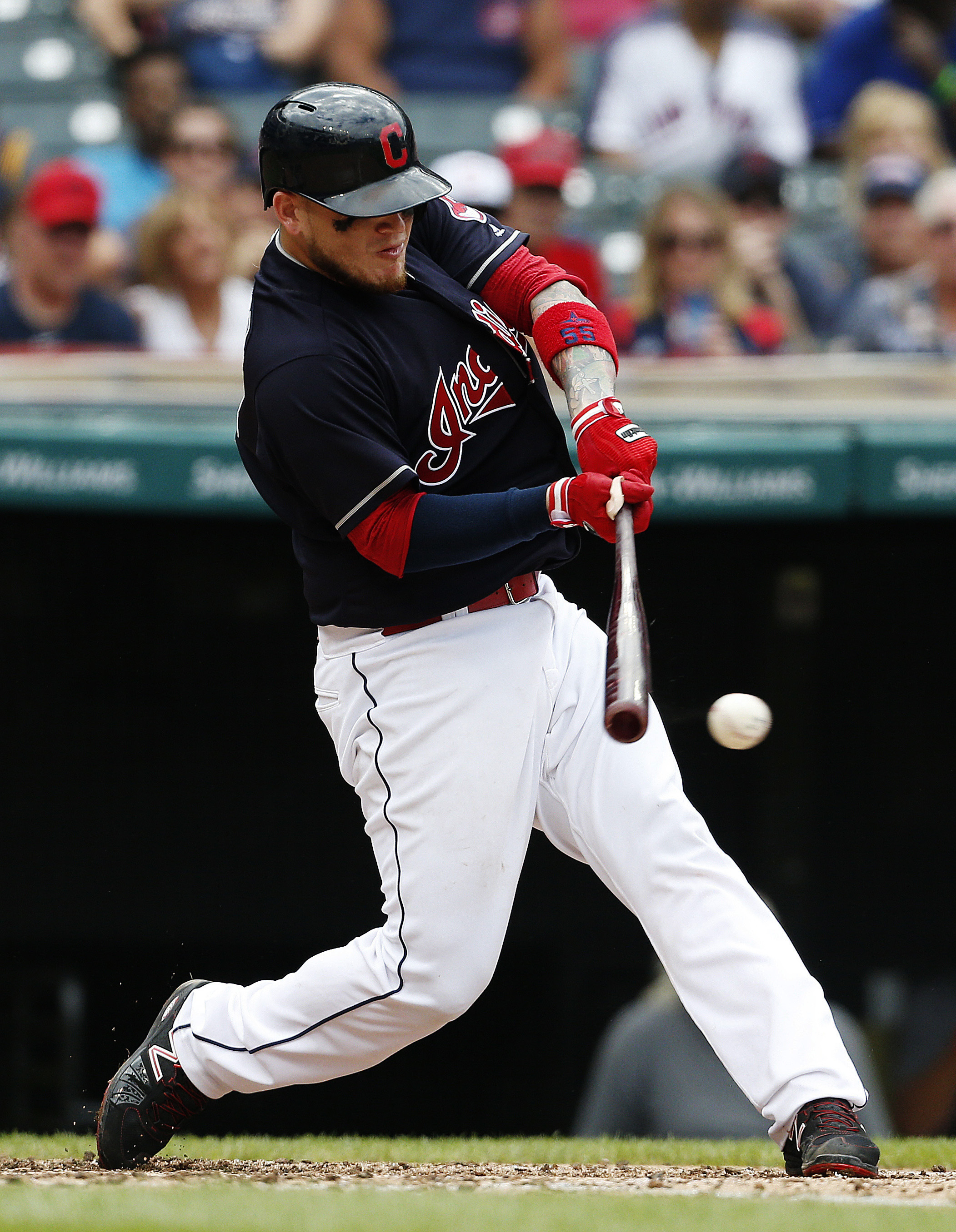 Cleveland Indians' Roberto Perez hits an RBI-single off Oakland Athletics starting pitcher Sonny Gray during the fourth inning of a baseball game Sunday, July 31, 2016, in Cleveland. (AP Photo/Ron Schwane)