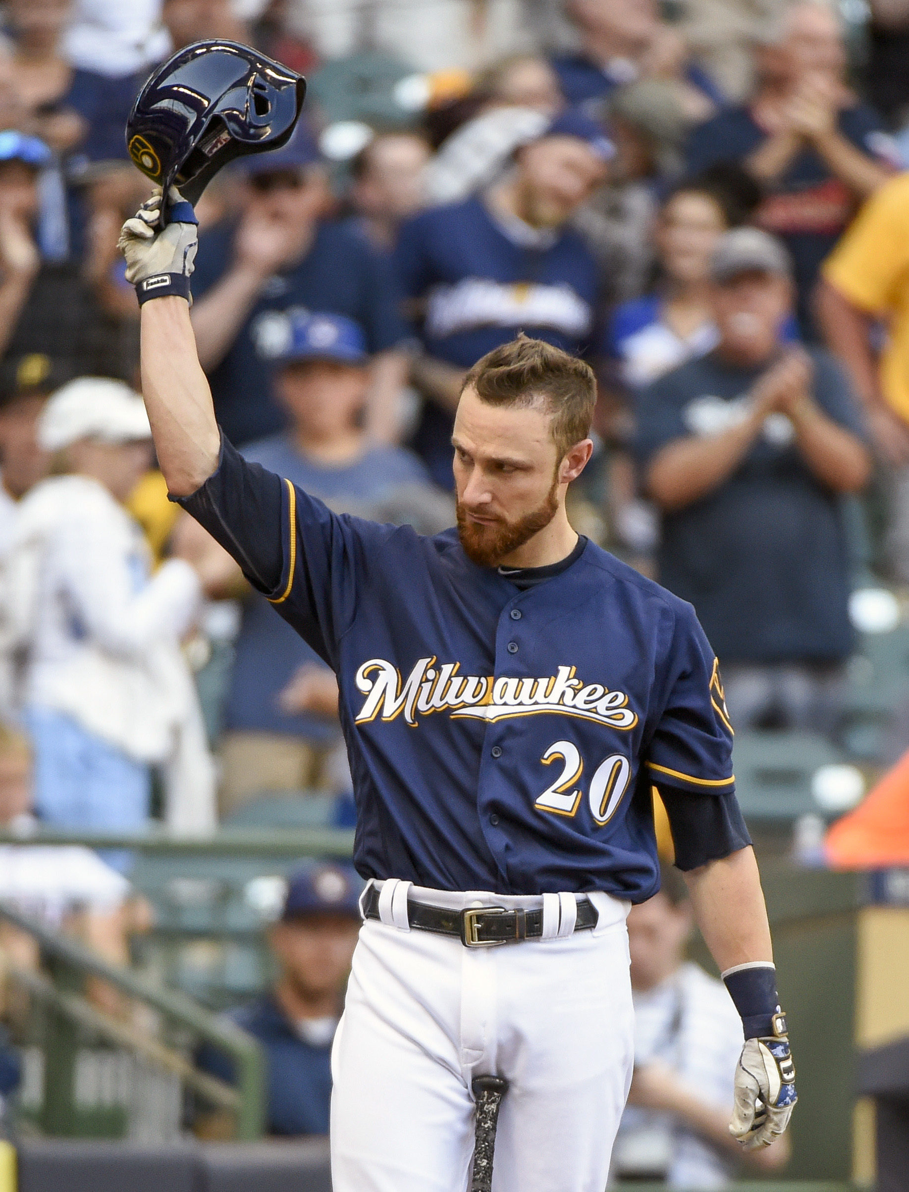 Milwaukee Brewers' Jonathan Lucroy tips his batting helmet after getting a standing ovation from fans while pinch-hitting during the eighth inning of a baseball game Sunday, July 31, 2016, in Milwaukee. Lucroy has blocked his proposed trade to the Clevela