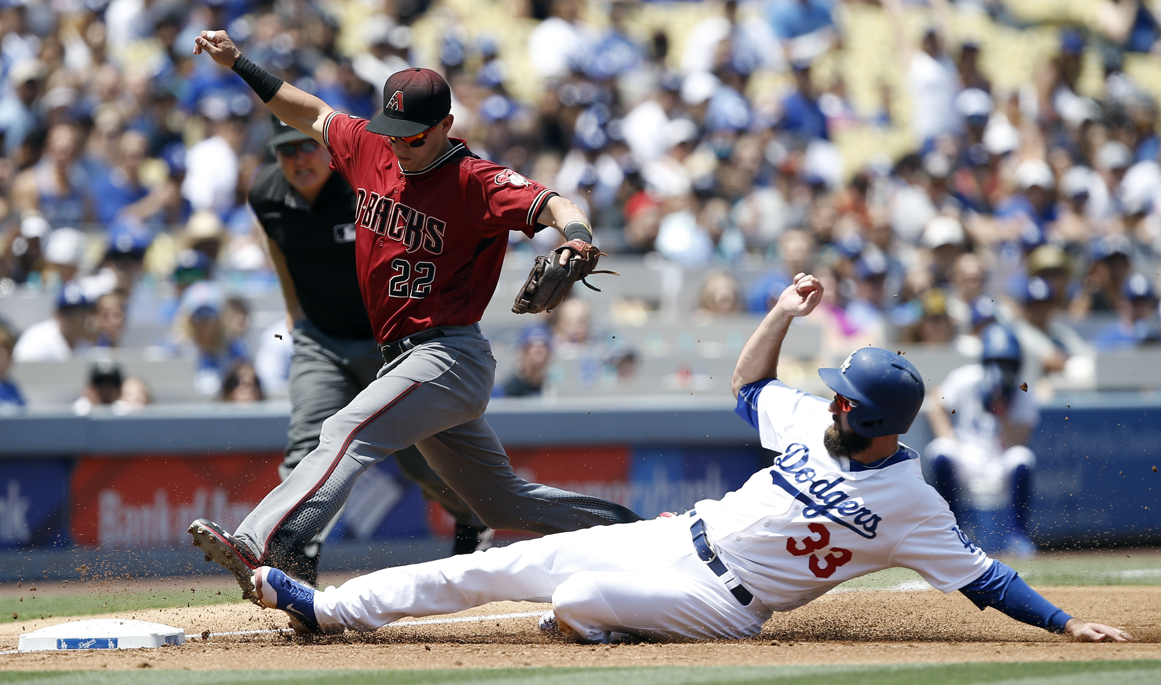 Arizona Diamondbacks third baseman Jake Lamb (22) races to beat Los Angeles Dodgers' Scott Van Slyke (33) to third for the out during the first inning of a baseball game in Los Angeles, Sunday, July 31, 2016. (AP Photo/Alex Gallardo)