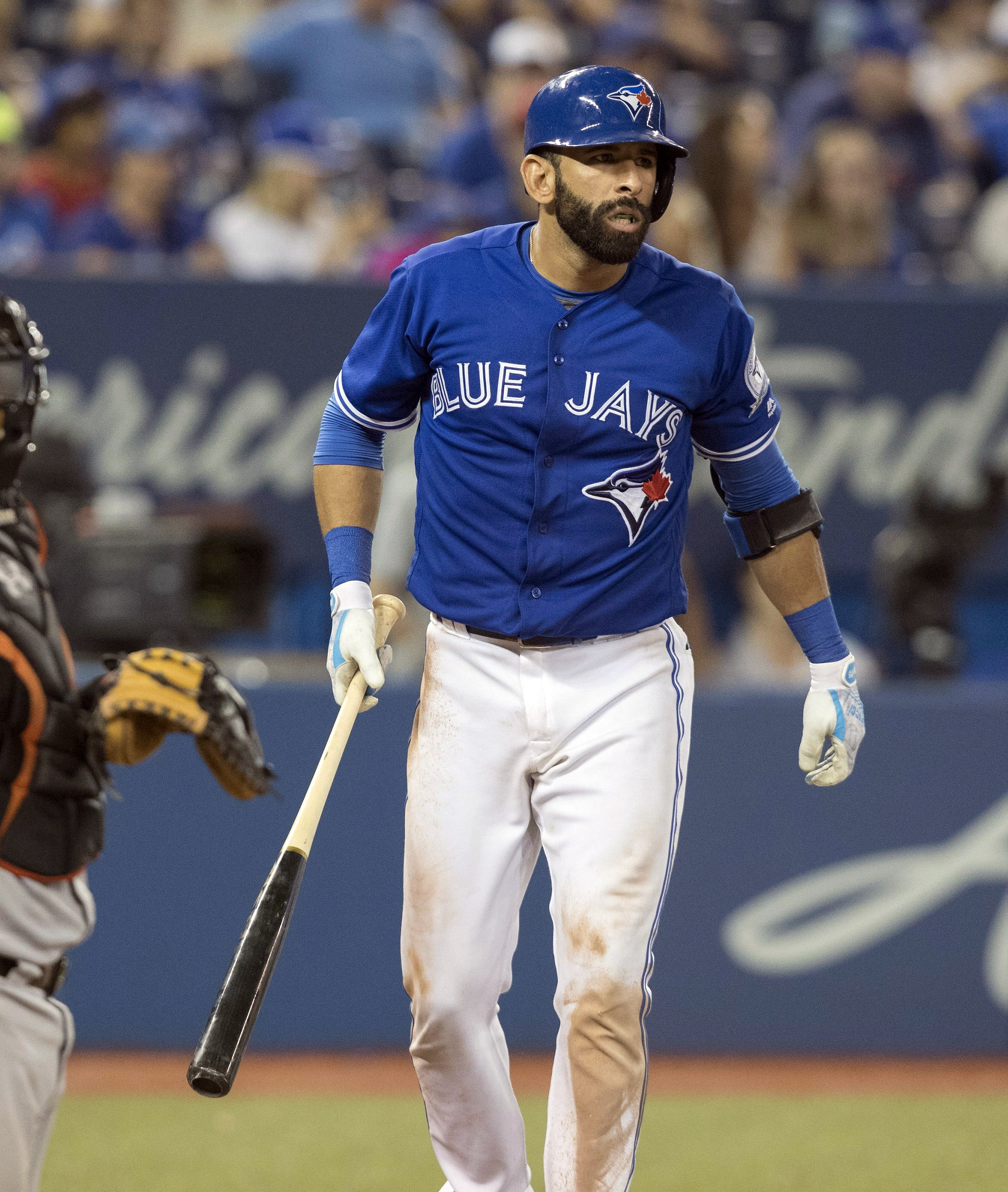 Toronto Blue Jays' Jose Bautista reacts after a called strike in the 12th inning of a baseball game against the Baltimore Orioles in Toronto, Sunday, July 31, 2016. (Fred Thornhill/The Canadian Press via AP)