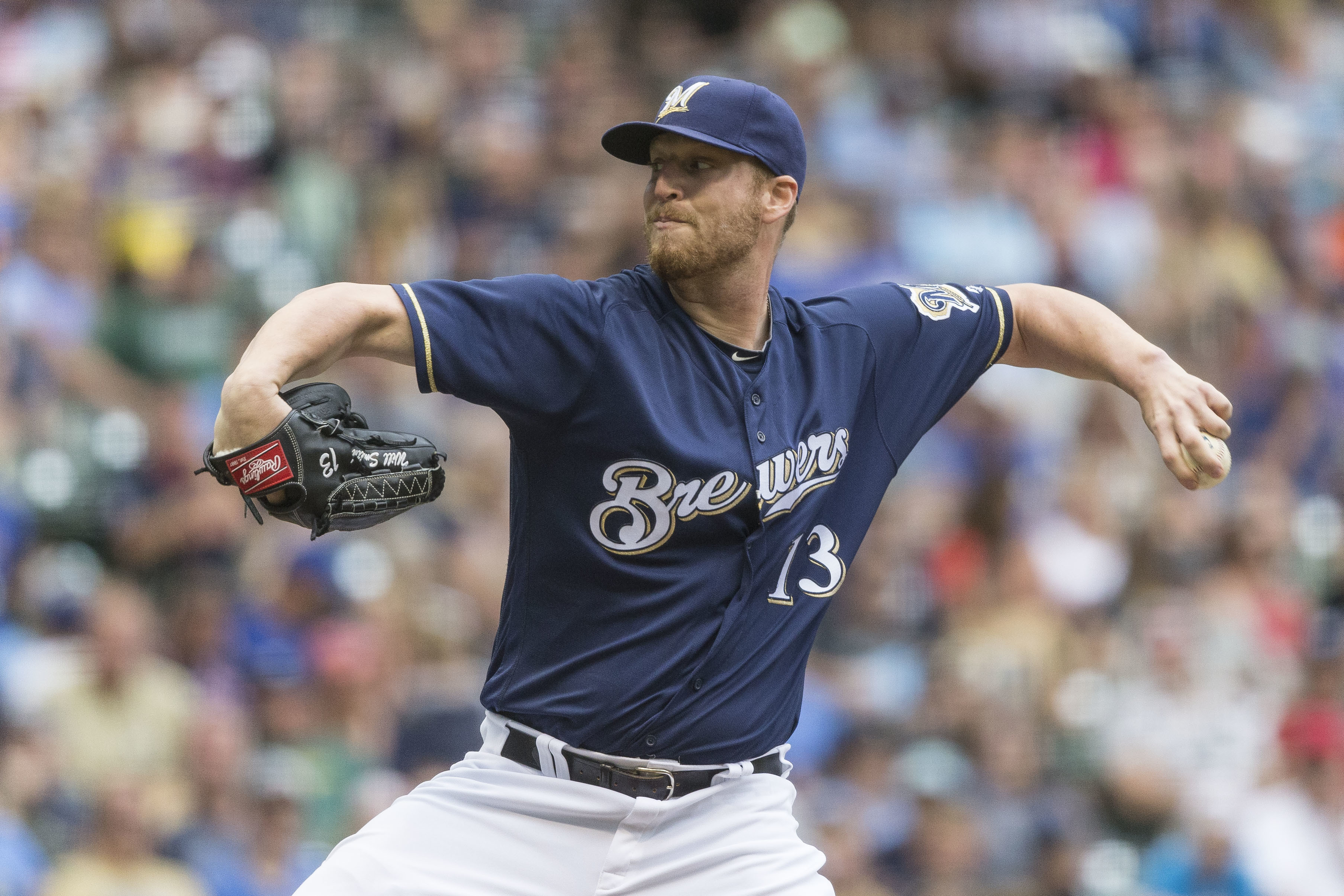 FILe - In this July 28, 2016, file photo, Milwaukee Brewers' Will Smith pitches to an Arizona Diamondbacks' batter during the seventh inning of a baseball game, in Milwaukee. A person with knowledge of the trade says the San Francisco Giants have acquired