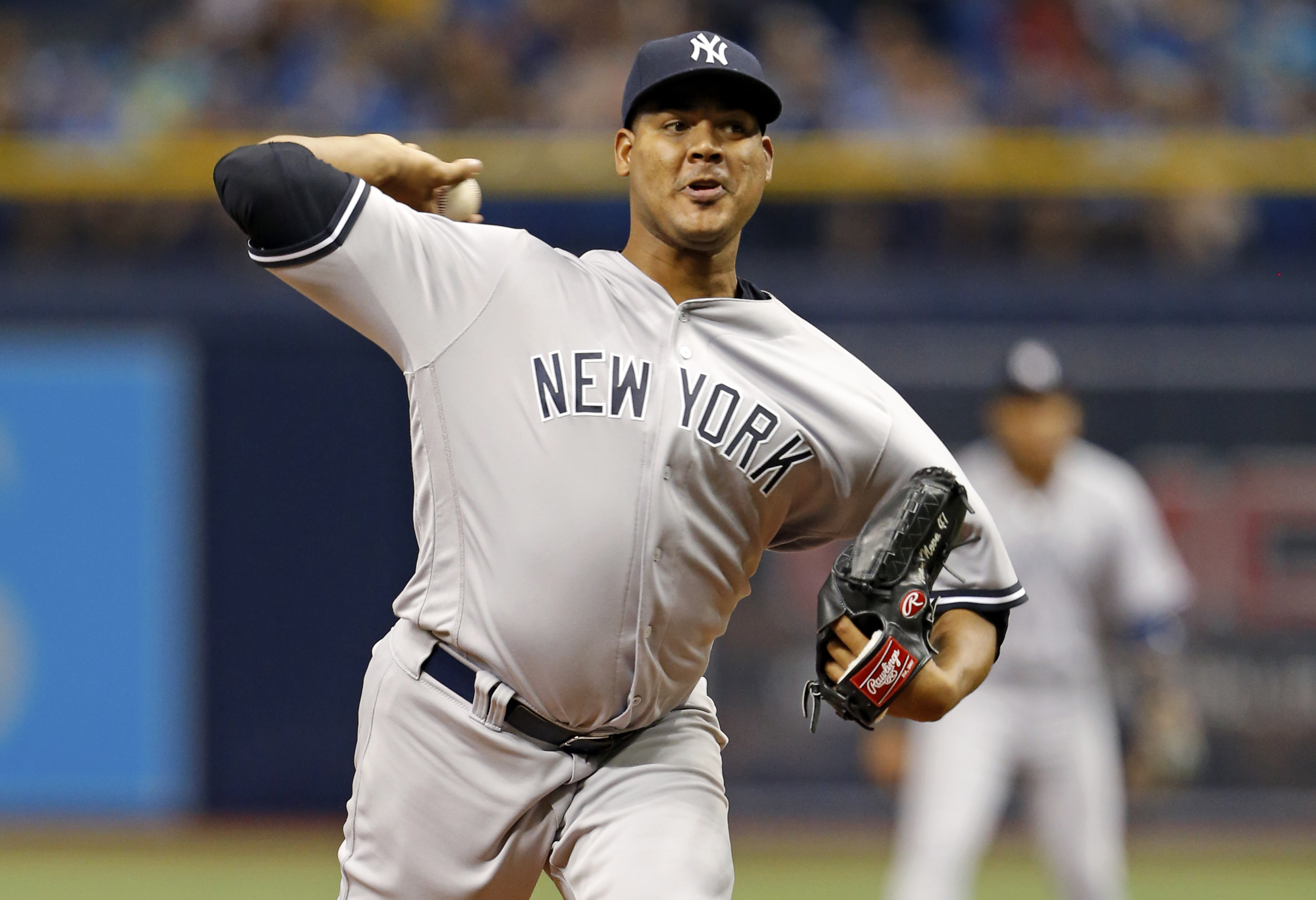 FILE - This July 29, 2016 file photo shows New York Yankees starting pitcher Ivan Nova throwing during the first inning of a baseball against the Tampa Bay Rays game in St. Petersburg, Fla. The retooling New York Yankees have dealt right-hander Ivan Nova