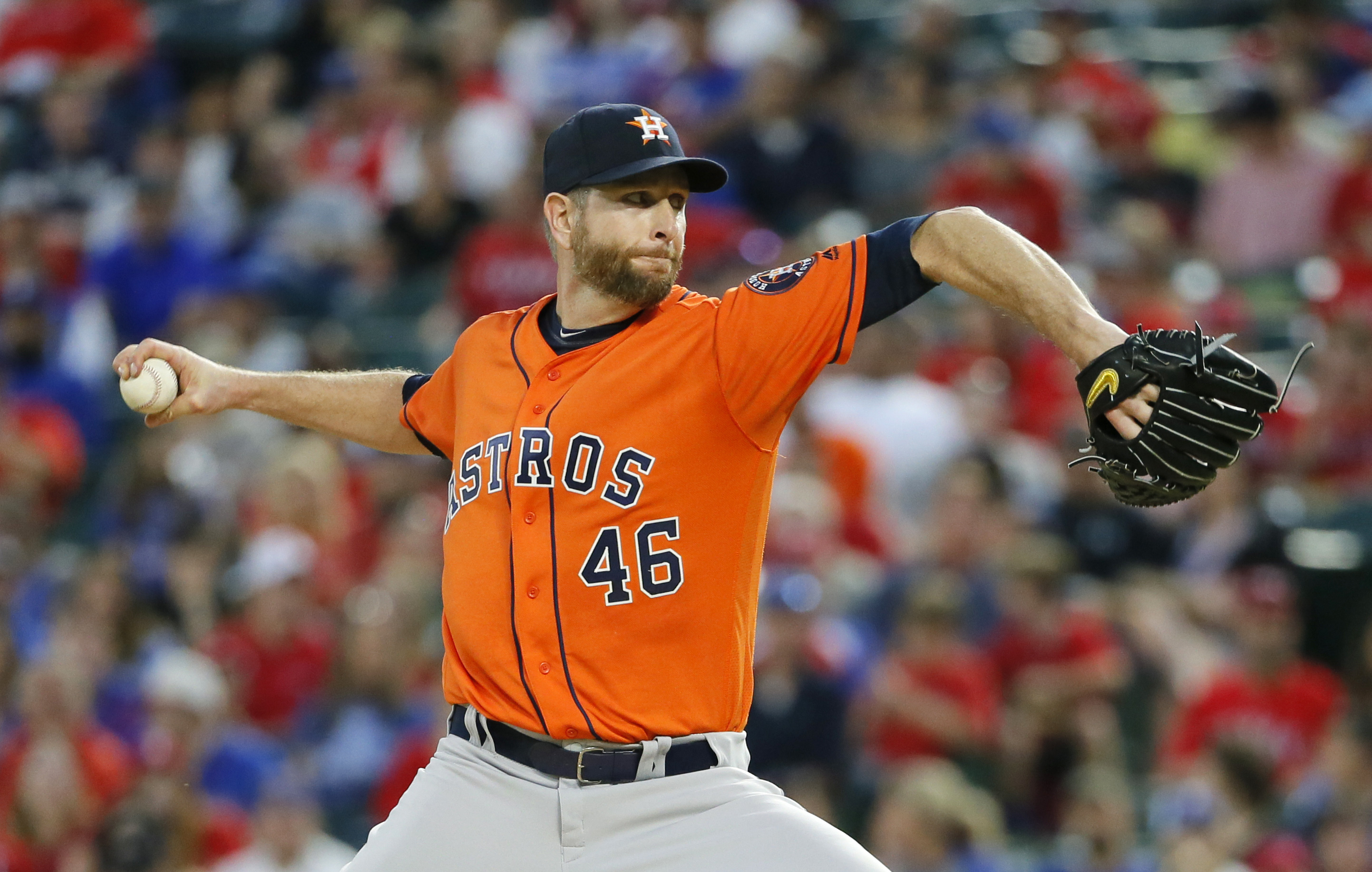 FILE - This April 19, 2016 file photo shows Houston Astros starting pitcher Scott Feldman working against the Texas Rangers in the second inning of a baseball game in Arlington, Texas. The Toronto Blue Jays have acquired right-hander Scott Feldman from th