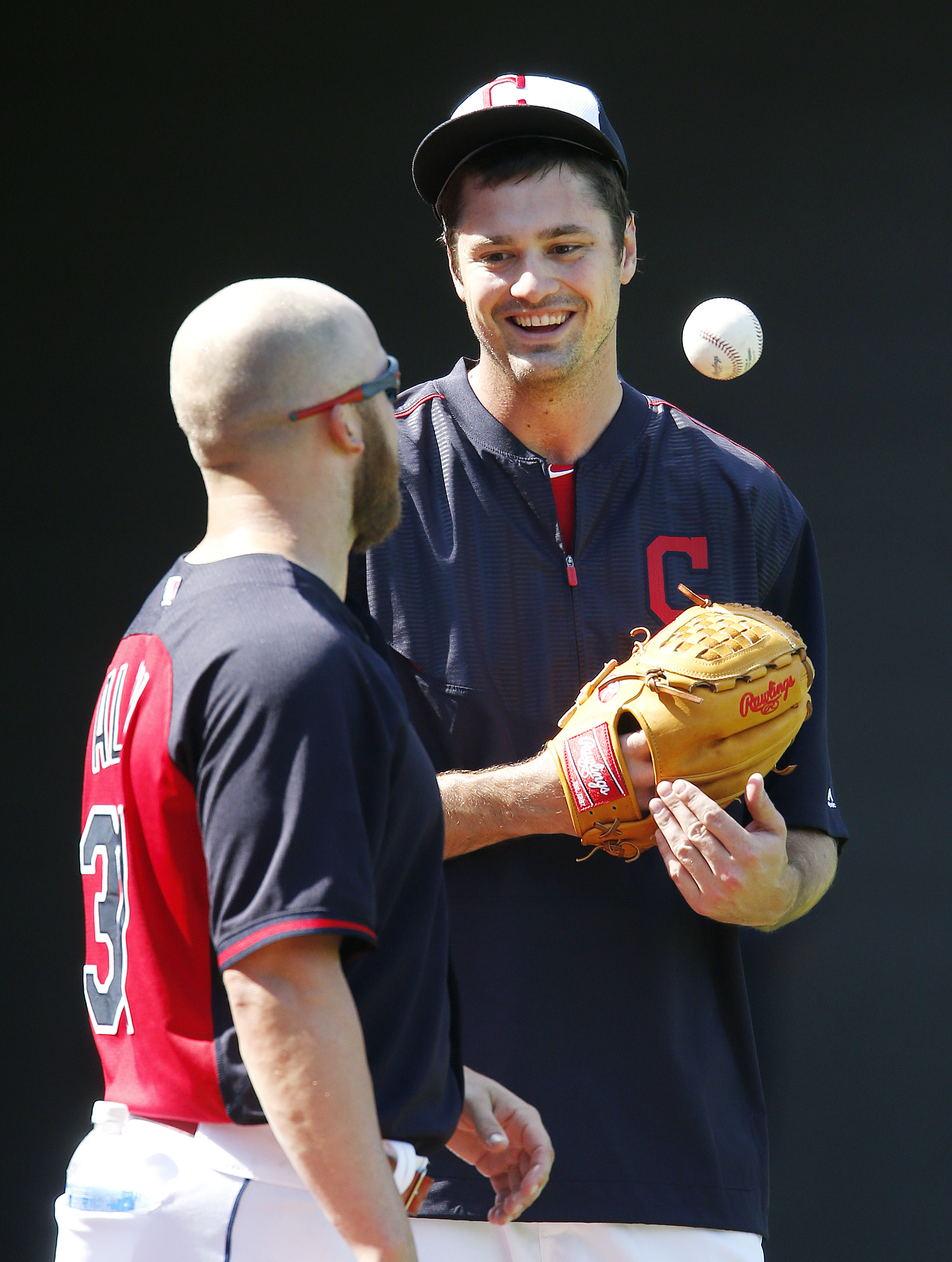 Cleveland Indians relief pitcher Andrew Miller, right, talks with relief pitcher Cody Allen during batting practice before a baseball game against the Minnesota Twins, Monday, Aug. 1, 2016, in Cleveland. (AP Photo/Ron Schwane)