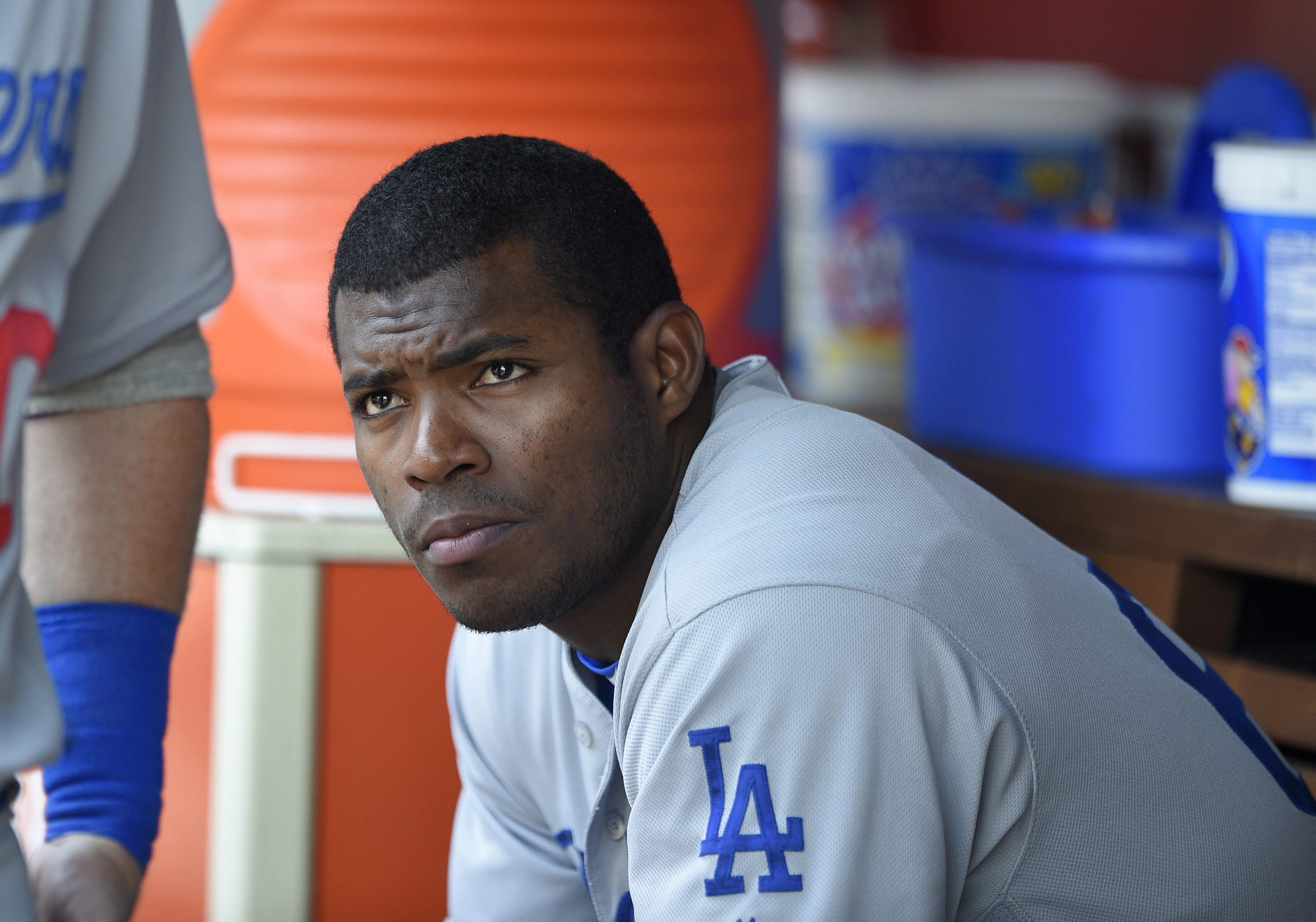 FILE - This July 21, 2016 file photo shows Los Angeles Dodgers' Yasiel Puig looking on from the dugout during a baseball game against the Washington Nationals in Washington. Puig's agent said Monday, Aug. 1, 2016 the Los Angeles Dodgers slugger expects to