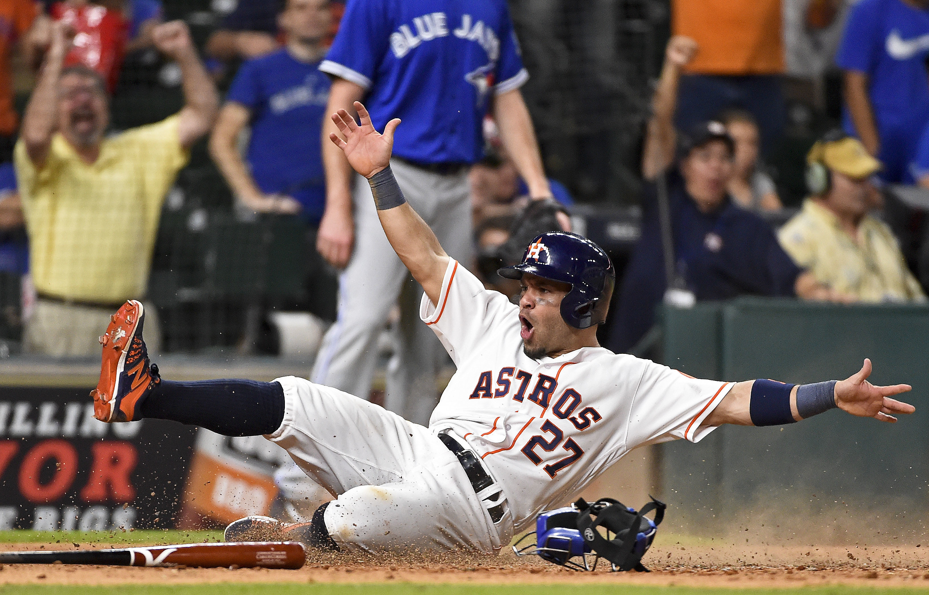 Houston Astros' Jose Altuve scores the winning run on Carlos Correa's single in the 14th inning of a baseball game against the Toronto Blue Jays, Monday, Aug. 1, 2016, in Houston. Houston won 2-1. (AP Photo/Eric Christian Smith)
