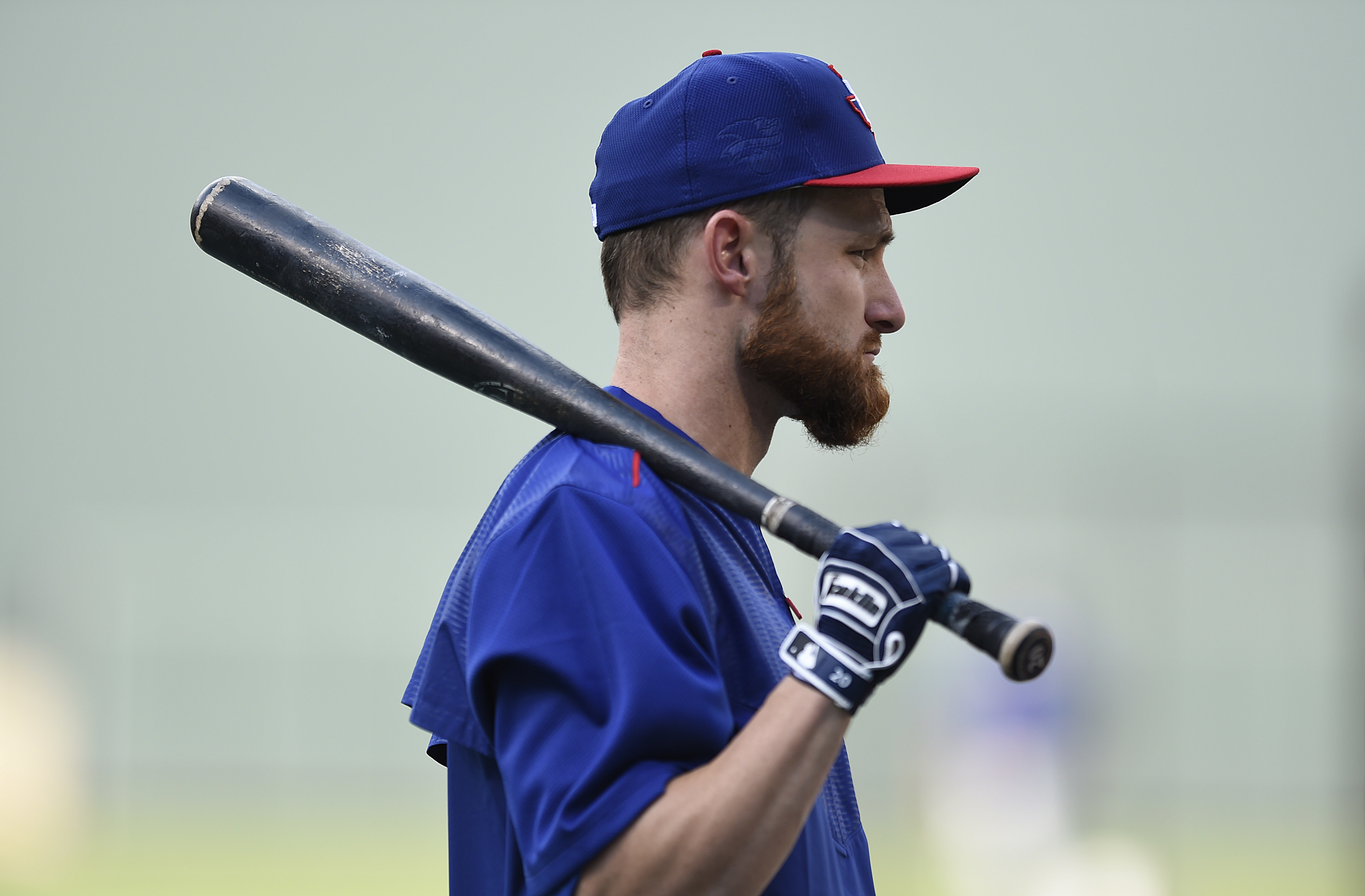 Texas Rangers' Jonathan Lucroy awaits his turn during batting practice before a baseball game between the Baltimore Orioles and the Texas Rangers in Baltimore. Tuesday, Aug. 2, 2016. (AP Photo/Gail Burton)