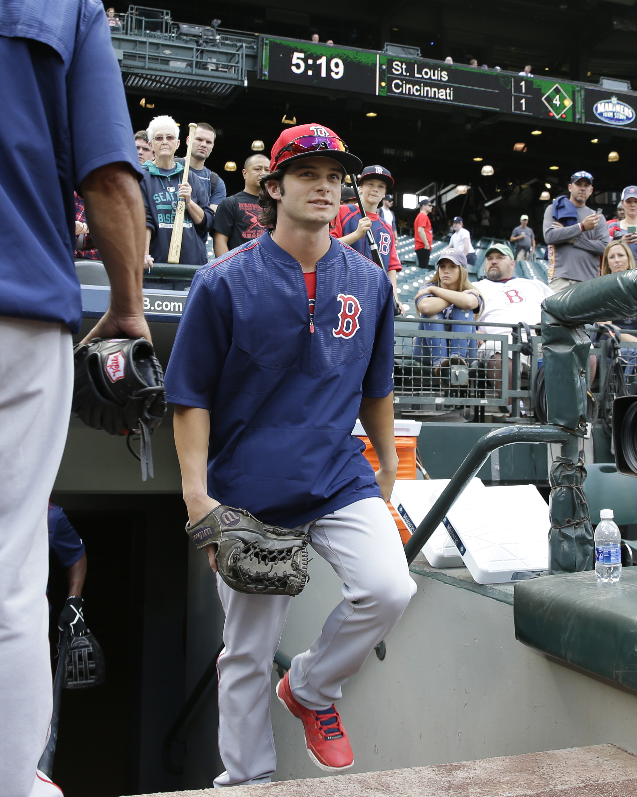 Boston Red Sox outfielder Andrew Benintendi walks out of the dugout to take batting practice prior to the team's baseball game against the Seattle Mariners, Tuesday, Aug. 2, 2016, in Seattle. (AP Photo/Ted S. Warren)