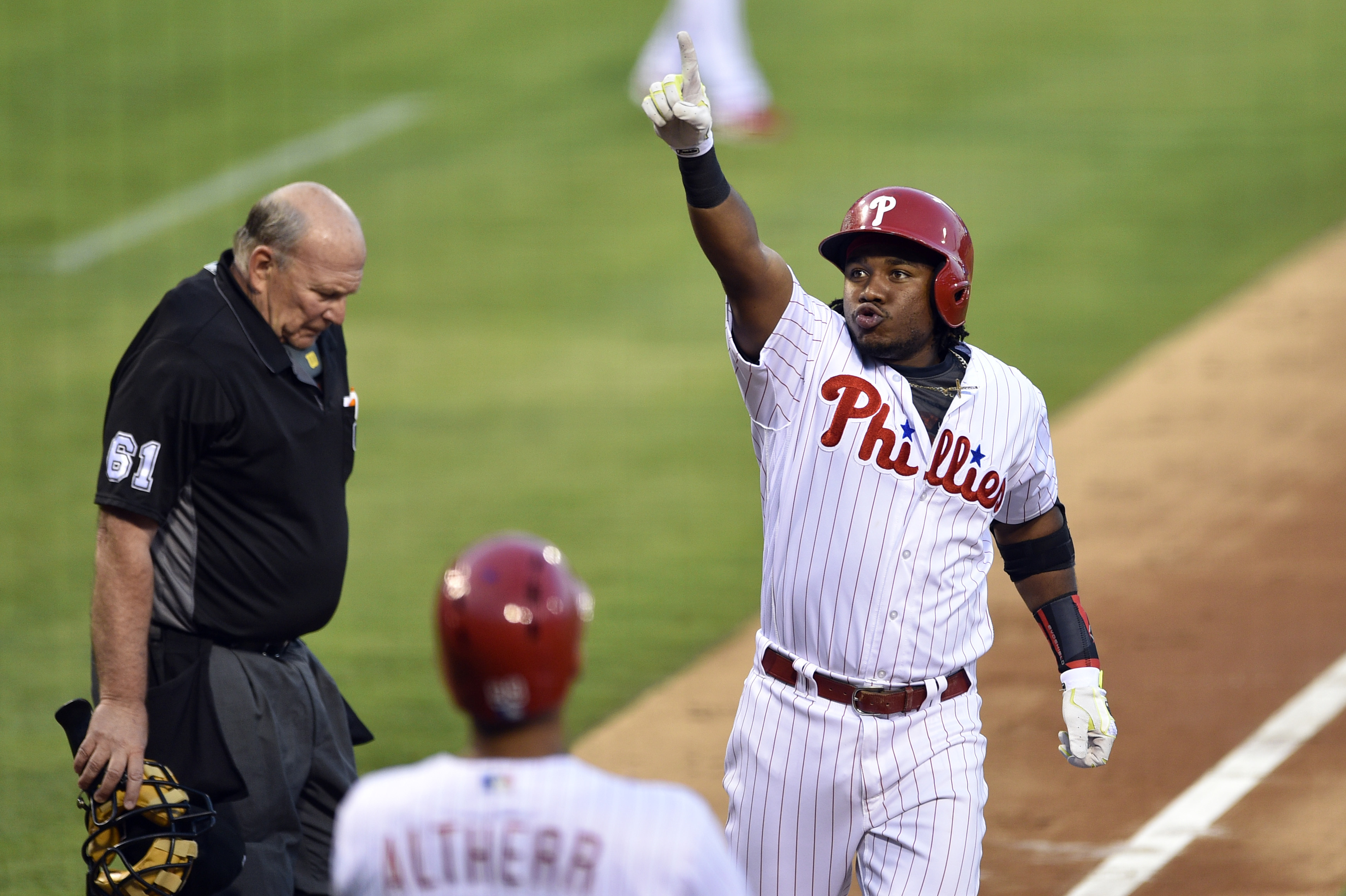 Philadelphia Phillies' Maikel Franco, right, points to the crowd after hitting a three-run home run off San Francisco Giants' Madison Bumgarner during the second inning of a baseball game, Tuesday, Aug. 2, 2016, in Philadelphia. (AP Photo/Derik Hamilton)