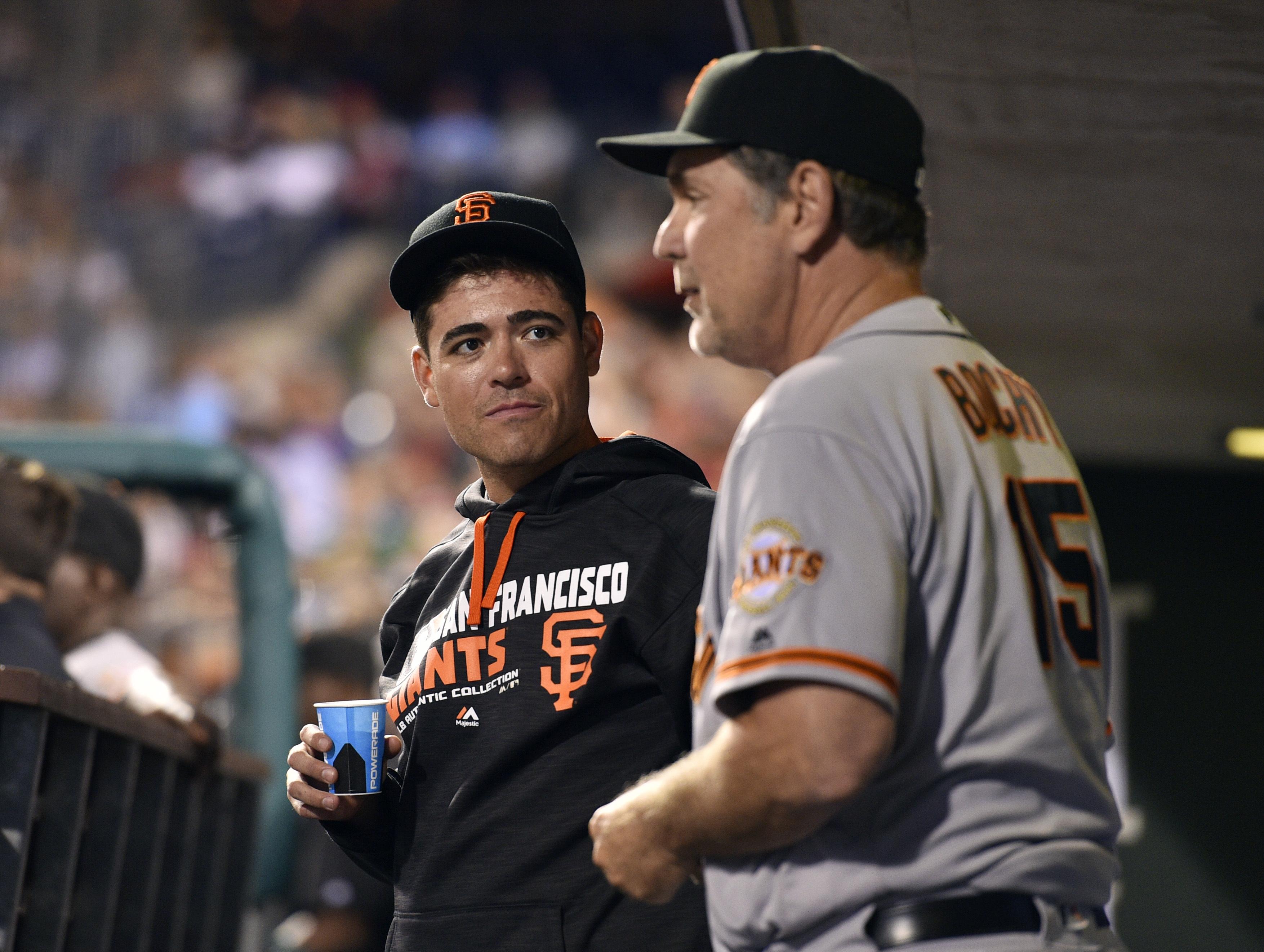 San Francisco Giants' Matt Moore, left, talks to manager Bruce Bochy in the dugout during a baseball game against the Philadelphia Phillies, Tuesday, Aug. 2, 2016, in Philadelphia. (AP Photo/Derik Hamilton)