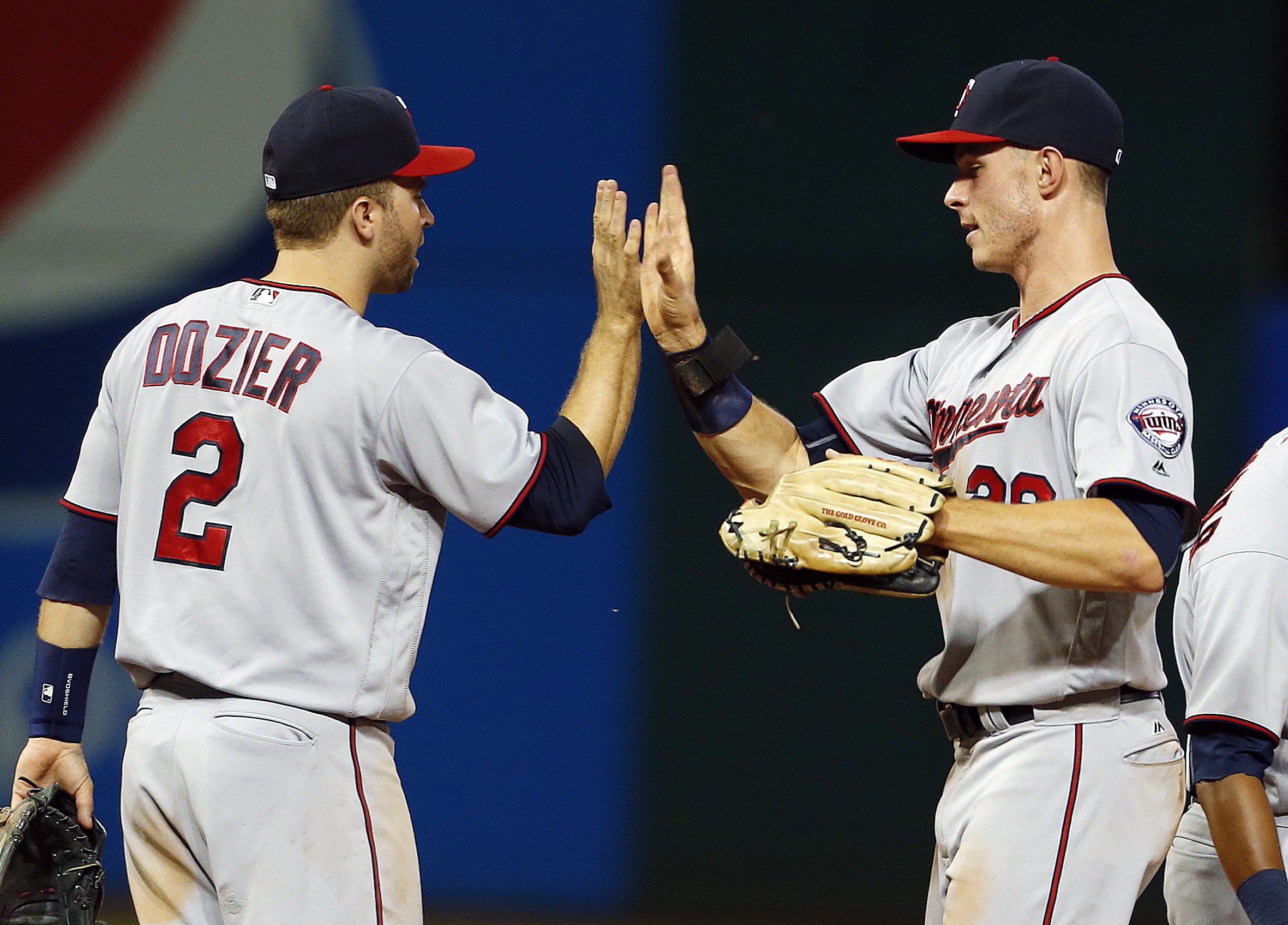 Minnesota Twins' Max Kepler and Brian Dozier (2) celebrate the team's 10-6 win over the Cleveland Indians in a baseball game Tuesday, Aug. 2, 2016, in Cleveland. (AP Photo/Ron Schwane)