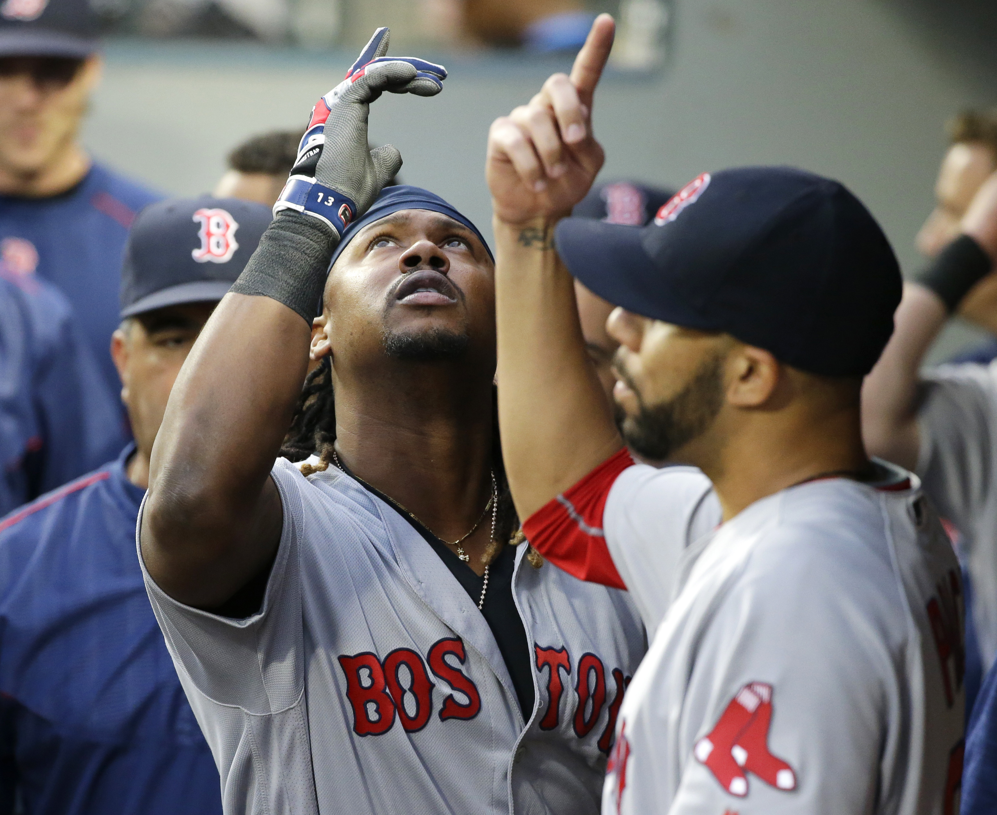 Boston Red Sox's Hanley Ramirez, left, celebrates with starting pitcher David Price, right, after Ramirez hit a solo home run during the fourth inning of a baseball game against the Seattle Mariners, Tuesday, Aug. 2, 2016, in Seattle. (AP Photo/Ted S. War