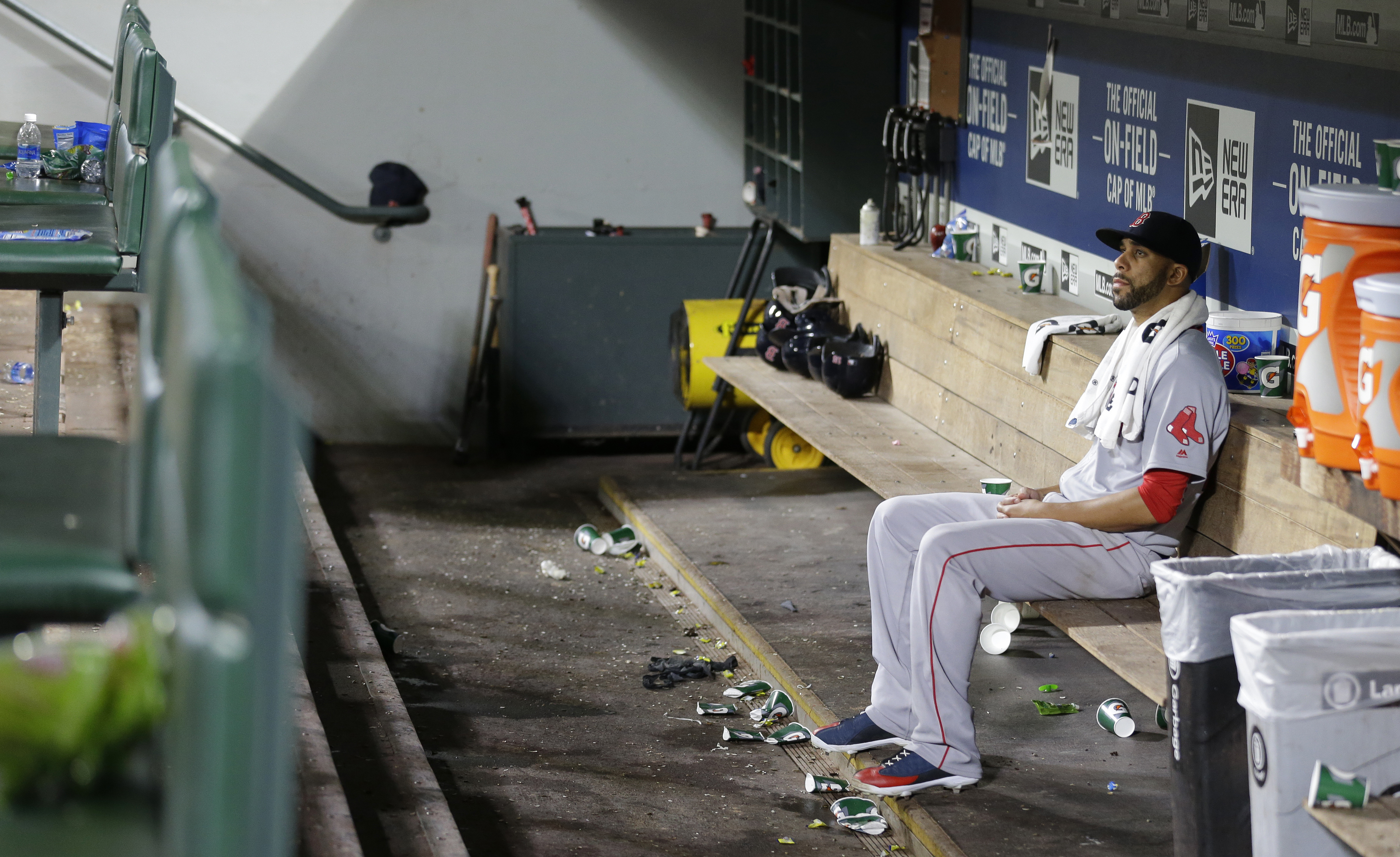 Boston Red Sox starting pitcher David Price sits alone in the dugout after the Seattle Mariners defeated the Red Sox 5-4 in a baseball game, Tuesday, Aug. 2, 2016, in Seattle. (AP Photo/Ted S. Warren)