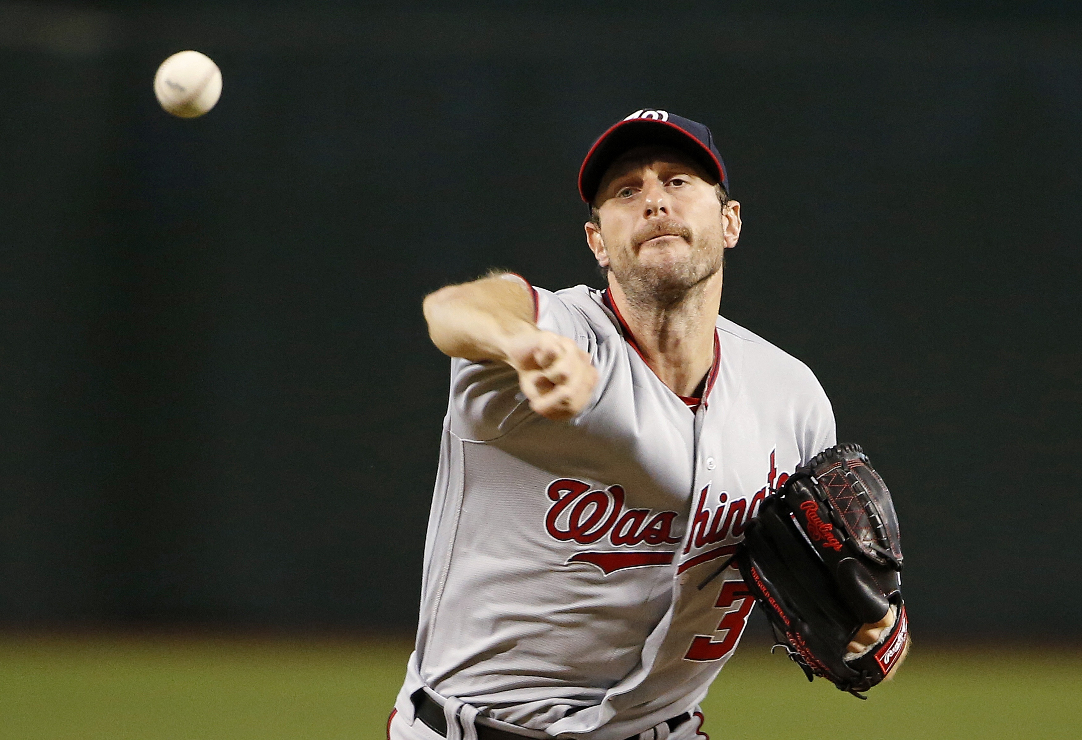 Washington Nationals' Max Scherzer warms up during the first inning of a baseball game against the Arizona Diamondbacks Wednesday, Aug. 3, 2016, in Phoenix. (AP Photo/Ross D. Franklin)