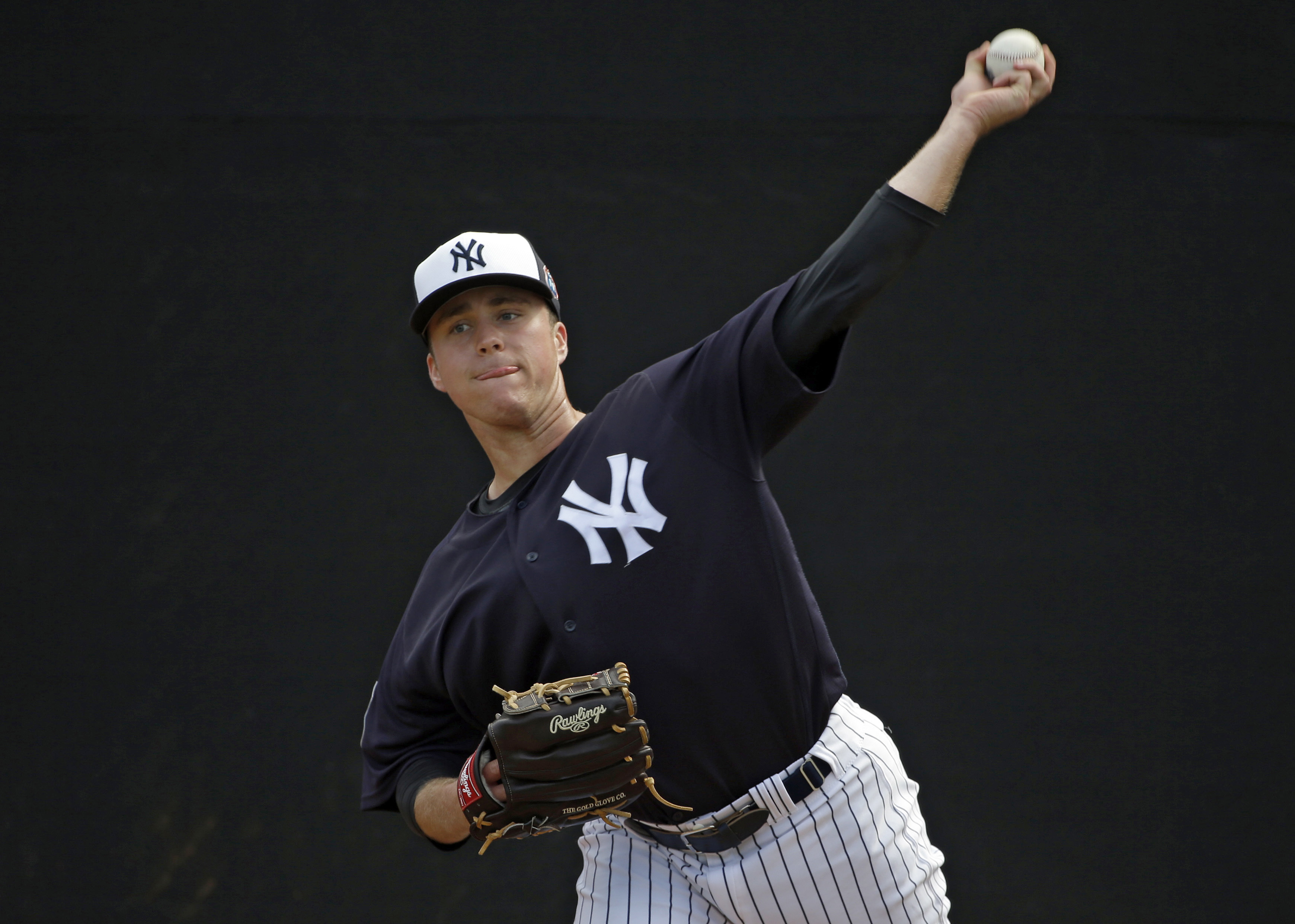FILE - In this March 5, 2016 file photo, New York Yankees relief pitcher Jacob Lindgren throws in the bullpen before a spring training baseball game against the Boston Red Sox in Tampa, Fla. Yankees left-hander Jacob Lindgren will have Tommy John surgery