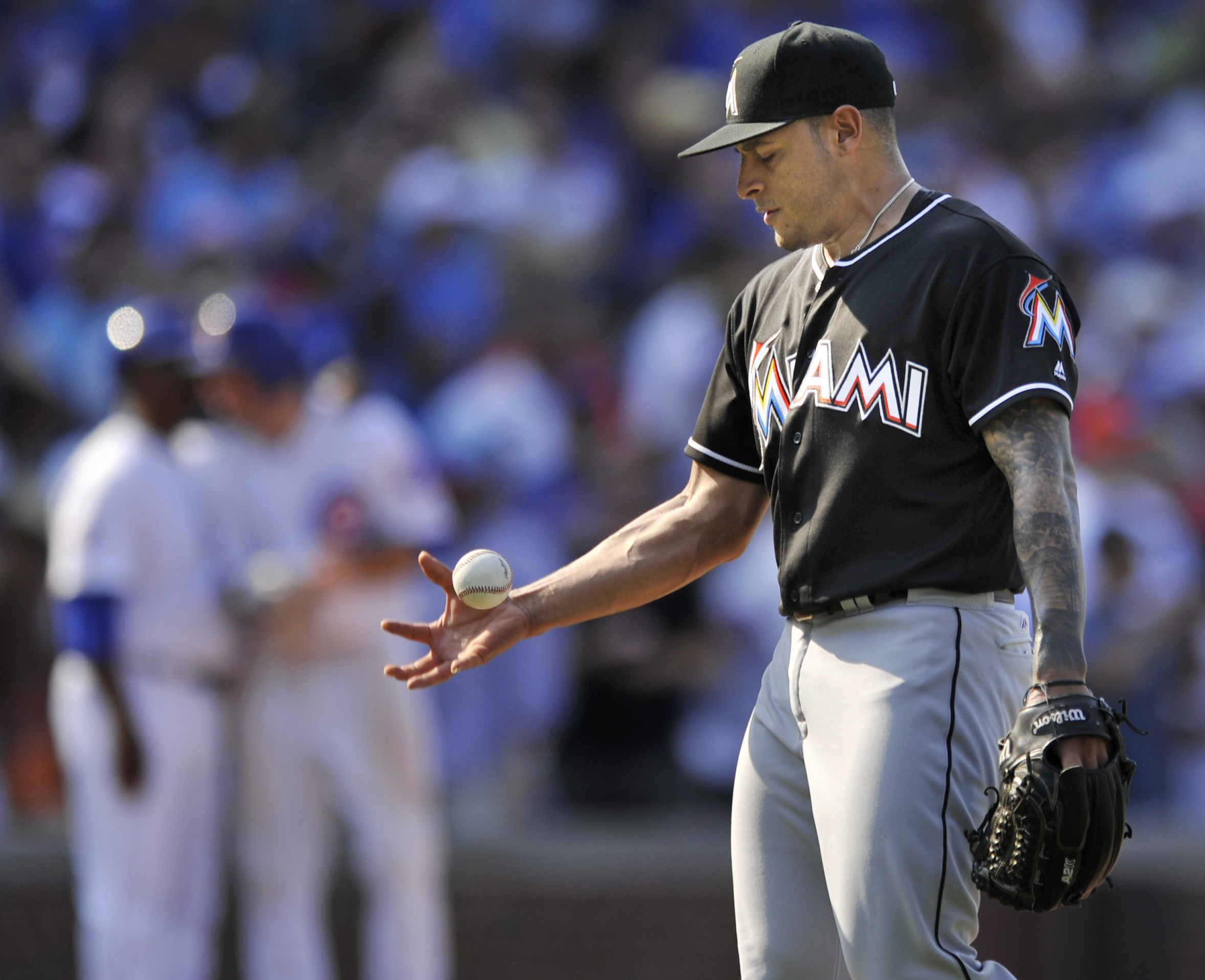 Miami Marlins closing pitcher A.J. Ramos reacts after walking Chicago Cubs' Ben Zobrist, scoring Javier Baez and loading the bases during the ninth inning of a baseball game Wednesday, Aug. 3, 2016, in Chicago. Chicago won 5-4. (AP Photo/Paul Beaty)