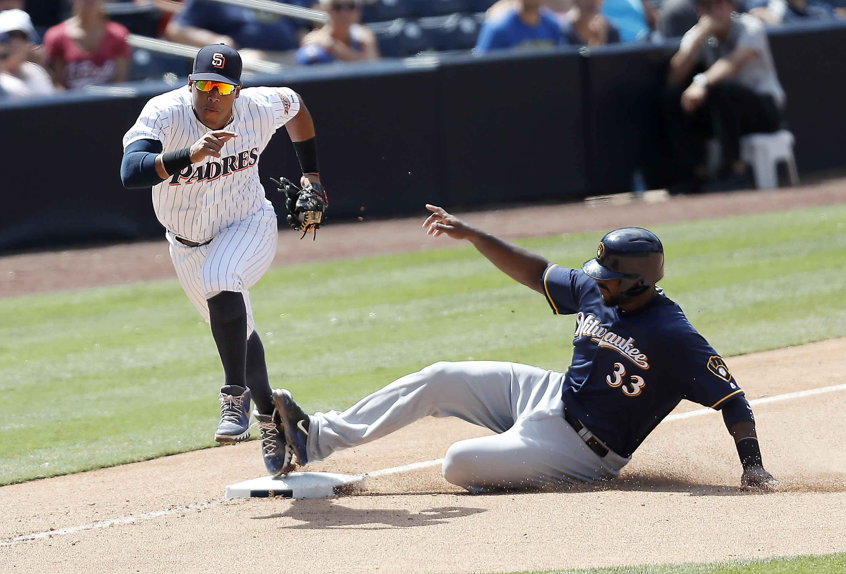 San Diego Padres third baseman Yangervis Solarte runs towards the dugout after getting Milwaukee Brewers first baseman Chris Carter out at third base during the seventh inning of a baseball game, Wednesday, Aug. 3, 2016, in San Diego. (AP Photo/Ryan Kang)