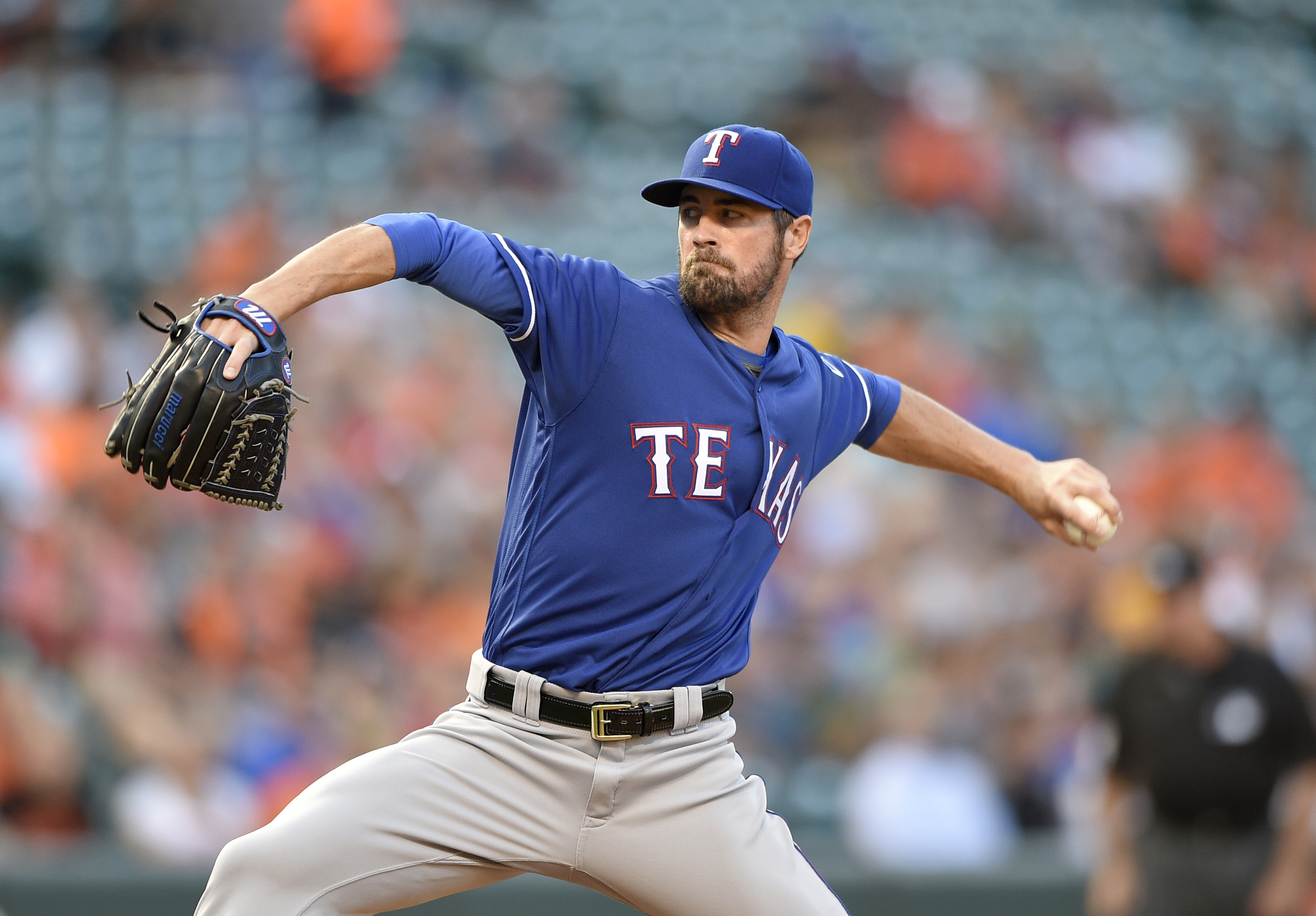 Texas Rangers starting pitcher Cole Hamels delivers a pitch during the first inning of a baseball game against the Baltimore Orioles, Wednesday, Aug. 3, 2016, in Baltimore. (AP Photo/Nick Wass)