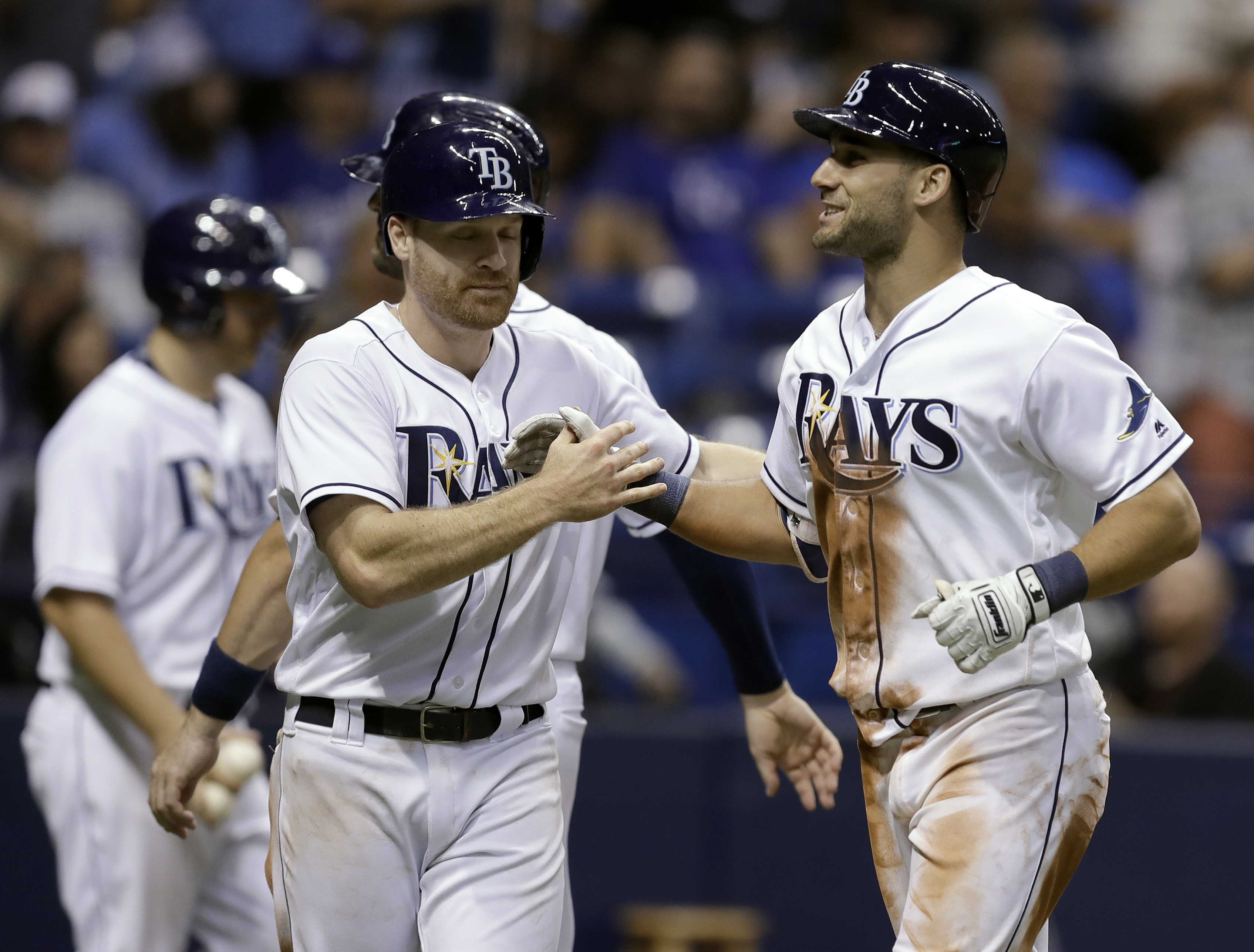 Tampa Bay Rays' Kevin Kiermaier, right, celebrates with Logan Forsythe after his three-run home run off Kansas City Royals relief pitcher Chien-Ming Wang during the sixth inning of a baseball game Wednesday, Aug. 3, 2016, in St. Petersburg, Fla. (AP Photo