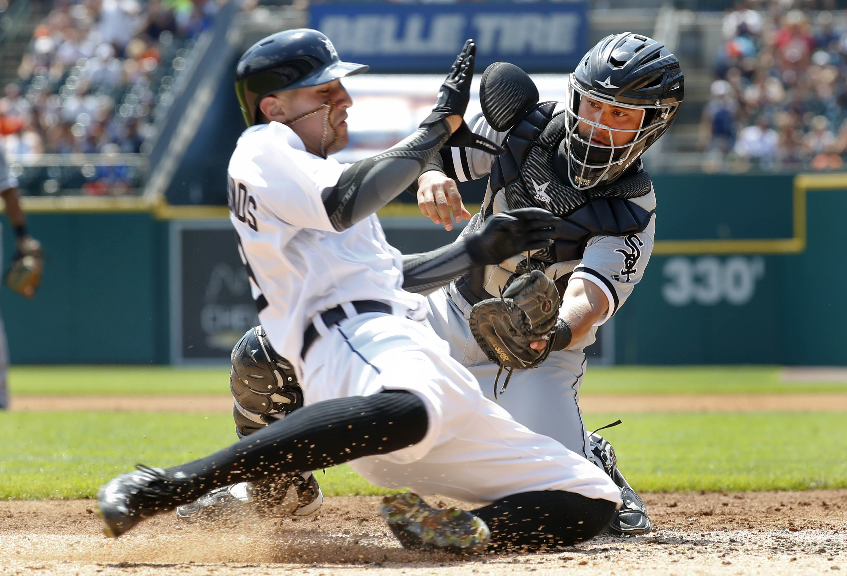 Chicago White Sox catcher Omar Narvaez tags Detroit Tigers' Nick Castellanos (9) out at home plate in the first inning of a baseball game Thursday, Aug. 4, 2016 in Detroit. (AP Photo/Paul Sancya)