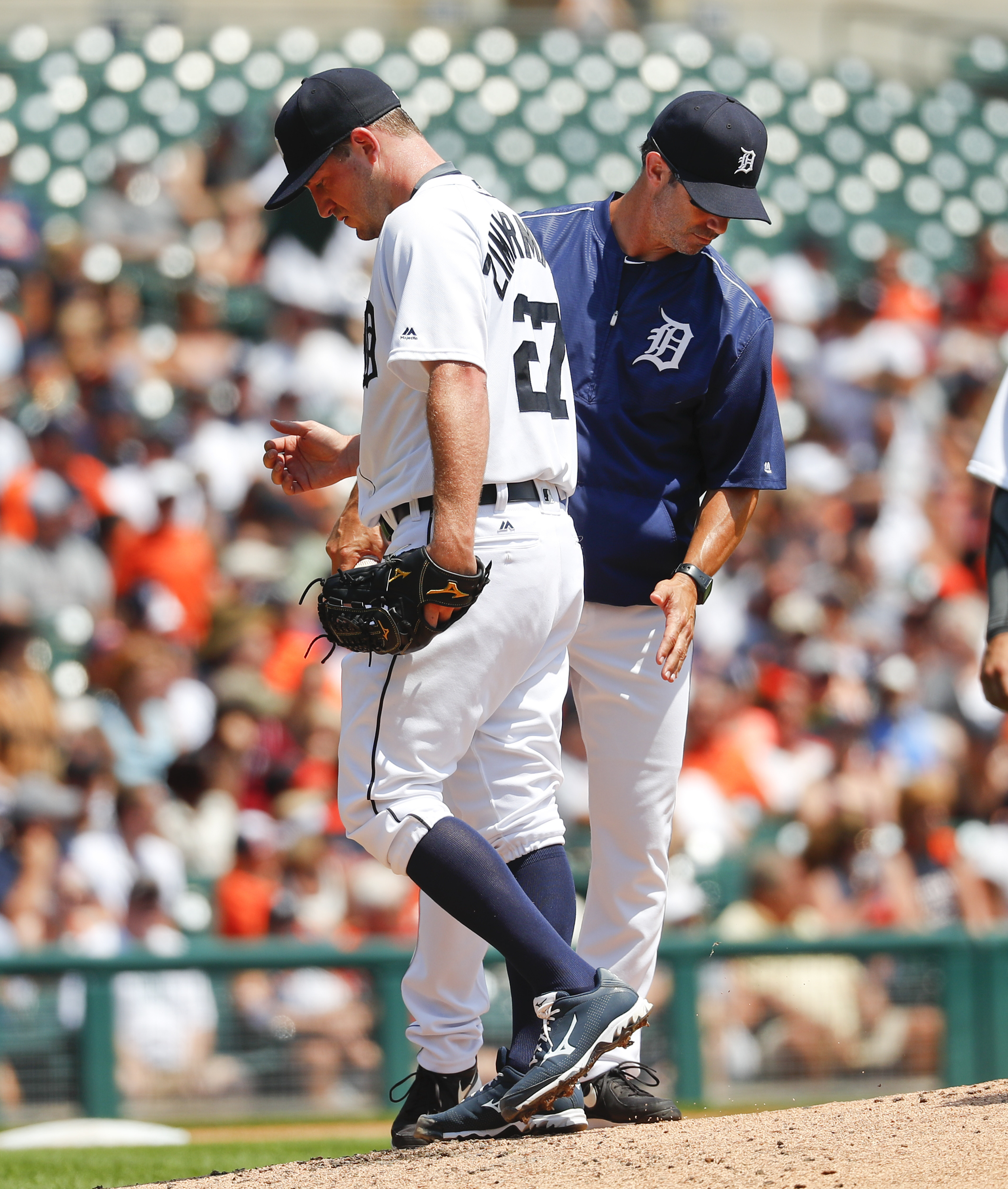 Detroit Tigers pitcher Jordan Zimmermann (27) is relieved by manager Brad Ausmus in the second inning of a baseball game against the Chicago White Sox, Thursday, Aug. 4, 2016 in Detroit. (AP Photo/Paul Sancya)