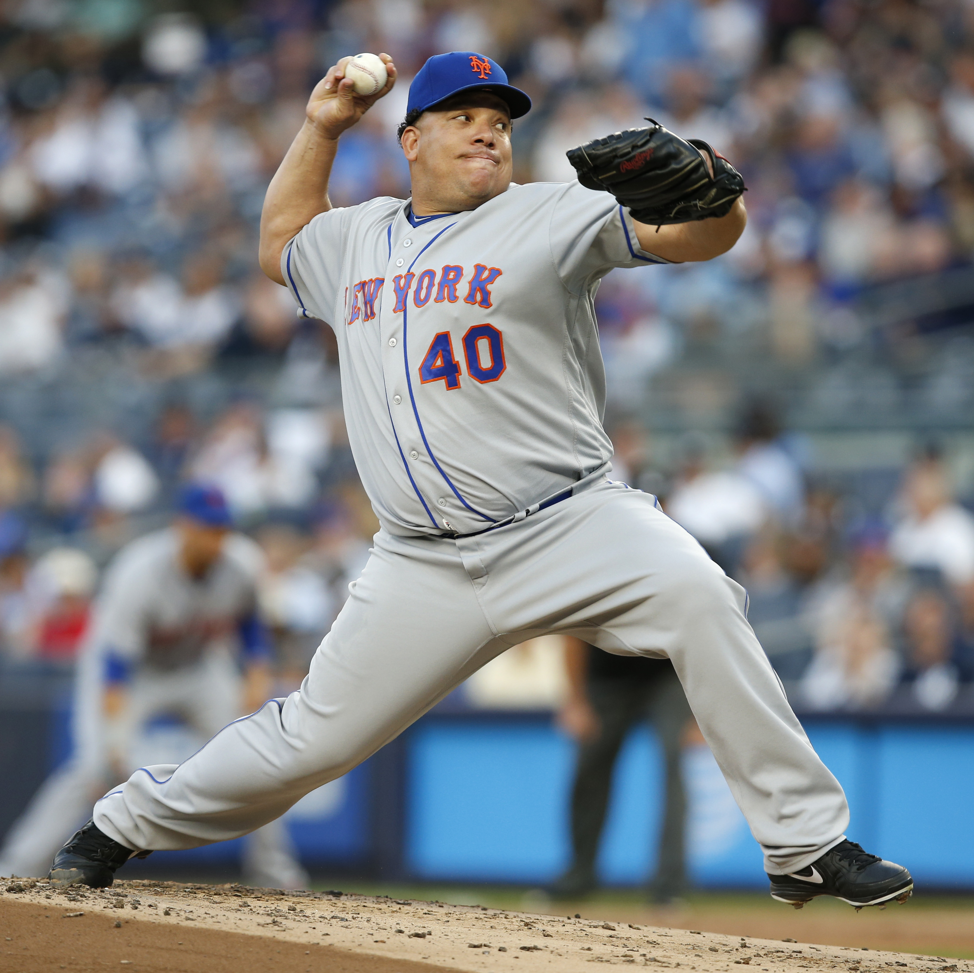 New York Mets starting pitcher Bartolo Colon winds up during the first inning of a baseball game against the New York Yankees, Thursday, Aug. 4, 2016, in New York. (AP Photo/Kathy Willens)