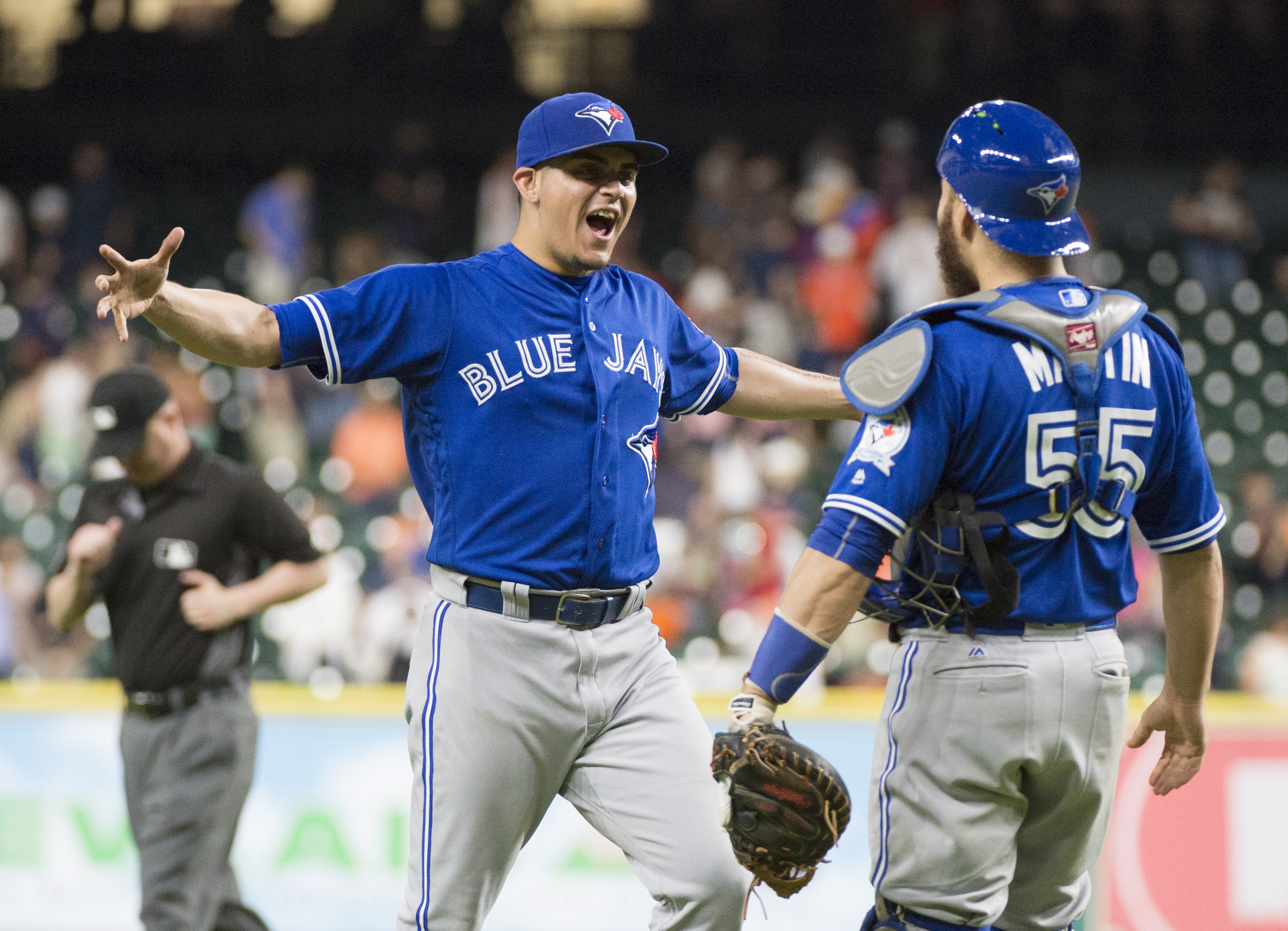 Toronto Blue Jays relief pitcher Roberto Osuna, left, celebrates with catcher Russell Martin a baseball game against the Houston Astros on Thursday, Aug. 4, 2016, in Houston. The Blue Jays won 4-1. (AP Photo/George Bridges)
