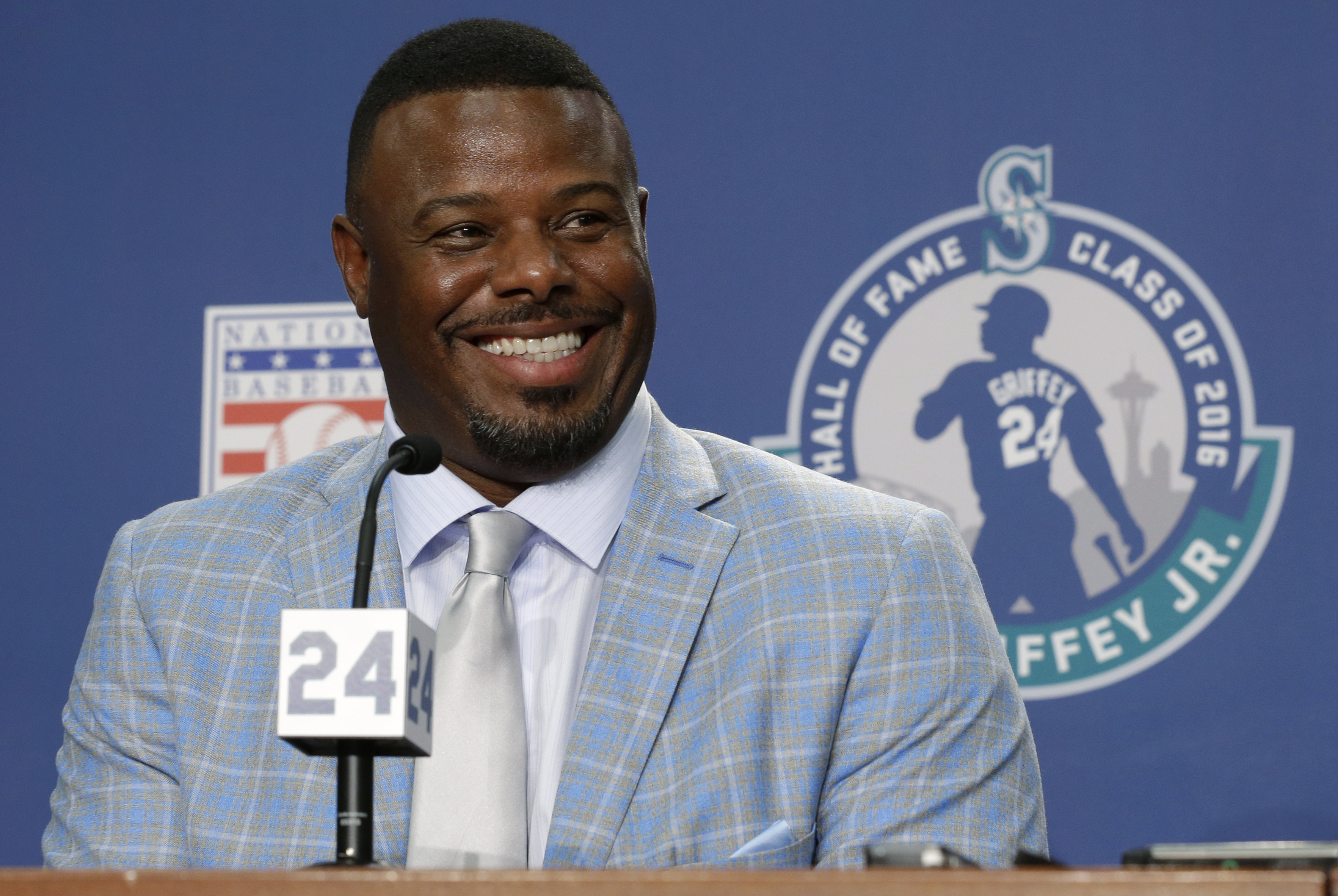 Seattle Mariners Hall-of-Famer Ken Griffey Jr. talks to reporters Friday, Aug. 5, 2016, before a baseball game between the Mariners and the Los Angeles Angels in Seattle. On Saturday, the Mariners will retire Griffey's No. 24. (AP Photo/Ted S. Warren)