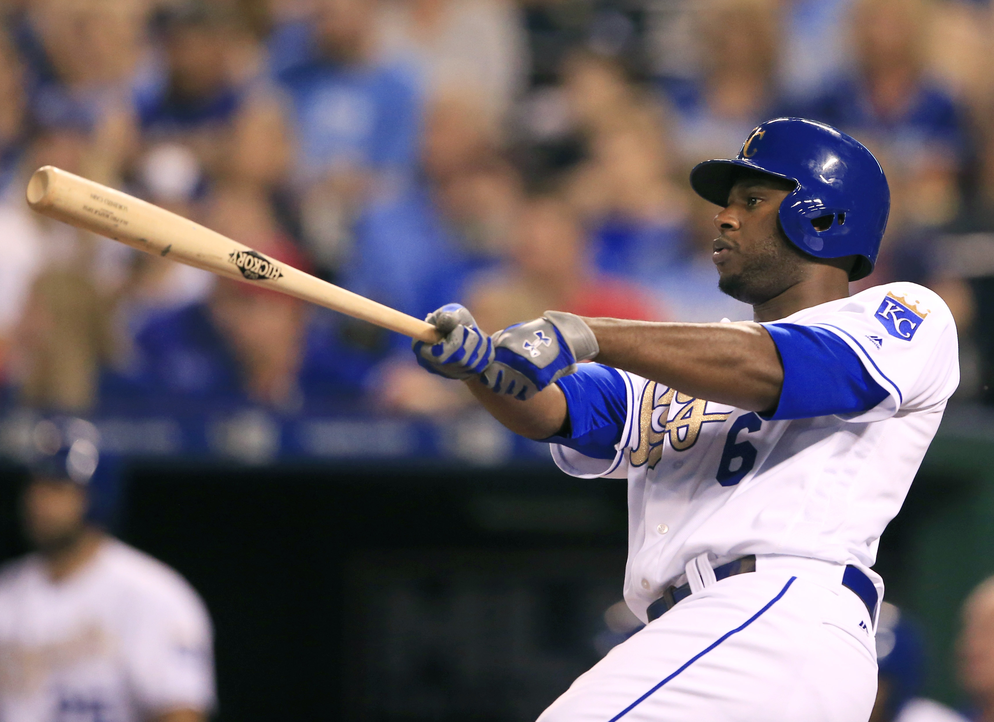 Kansas City Royals' Lorenzo Cain hits an RBI triple off Toronto Blue Jays starting pitcher Francisco Liriano during the fifth inning of a baseball game at Kauffman Stadium in Kansas City, Mo., Friday, Aug. 5, 2016. (AP Photo/Orlin Wagner)