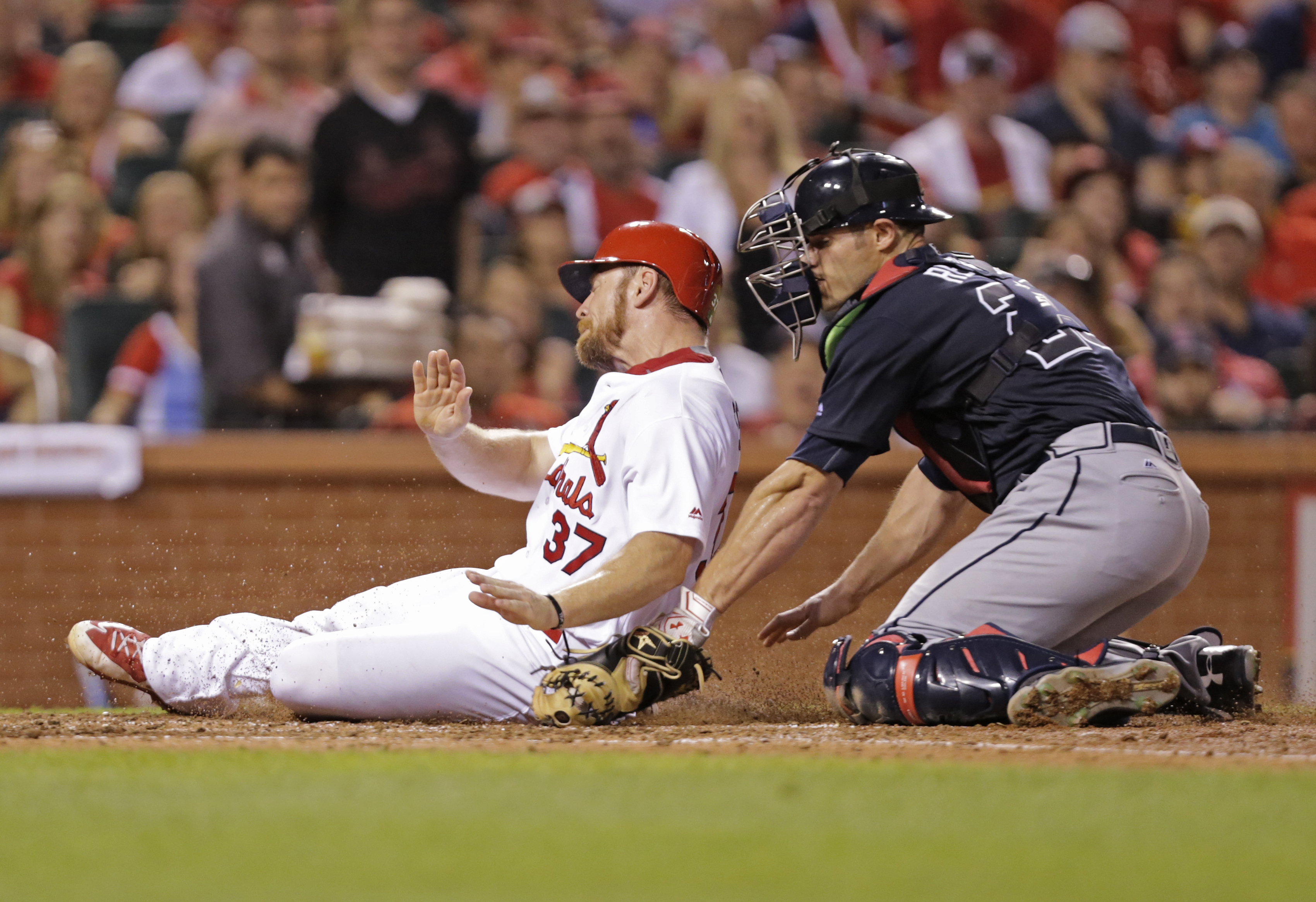 St. Louis Cardinals' Brandon Moss is tagged out at home by Atlanta Braves catcher Anthony Recker during the sixth inning of a baseball game, Friday, Aug. 5, 2016, in St. Louis. (AP Photo/Tom Gannam)