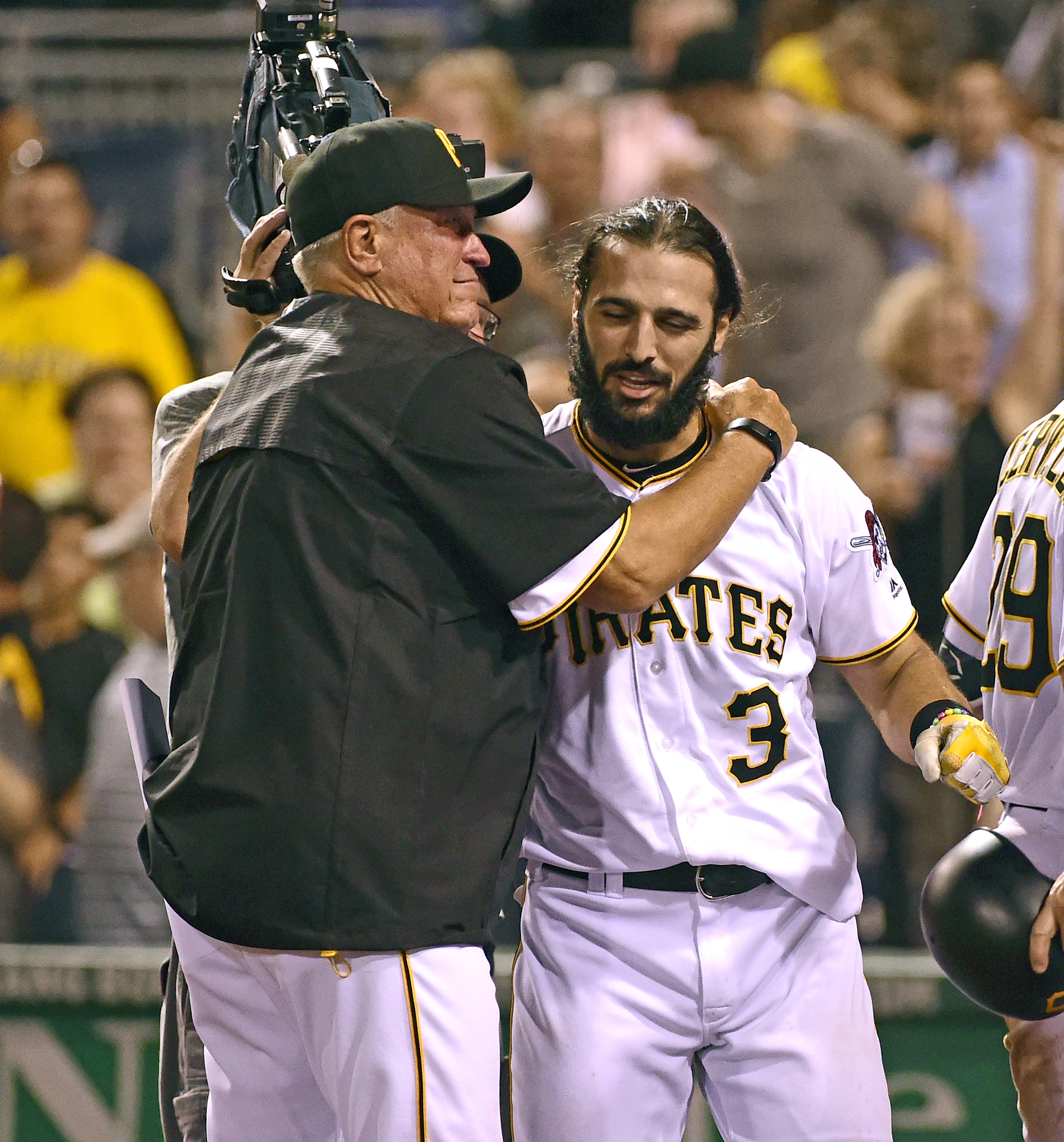 Pittsburgh Pirates manager Clint Hurdle, left, hugs Sean Rodriguez after Rodriguez hit a home run in the ninth inning of a baseball game against the Cincinnati Reds in Pittsburgh, Friday, Aug. 5, 2016. The Pirates won 3-2. (AP Photo/Fred Vuich)