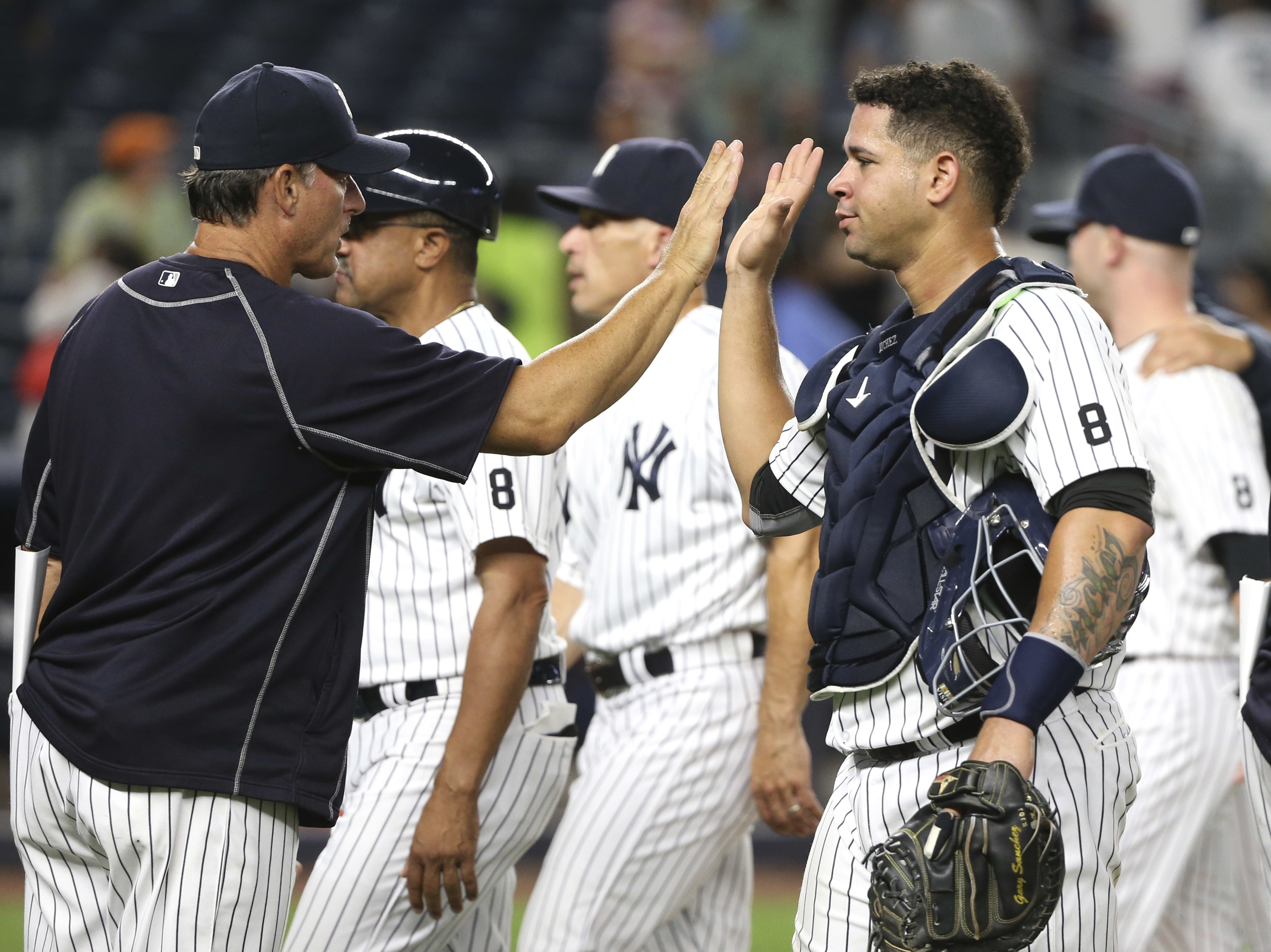 New York Yankees catcher Gary Sanchez, right, celebrates with teammates after the Yankees defeated the Cleveland Indians 13-7 in a baseball game Friday, Aug. 5, 2016 in New York. (AP Photo/Seth Wenig)