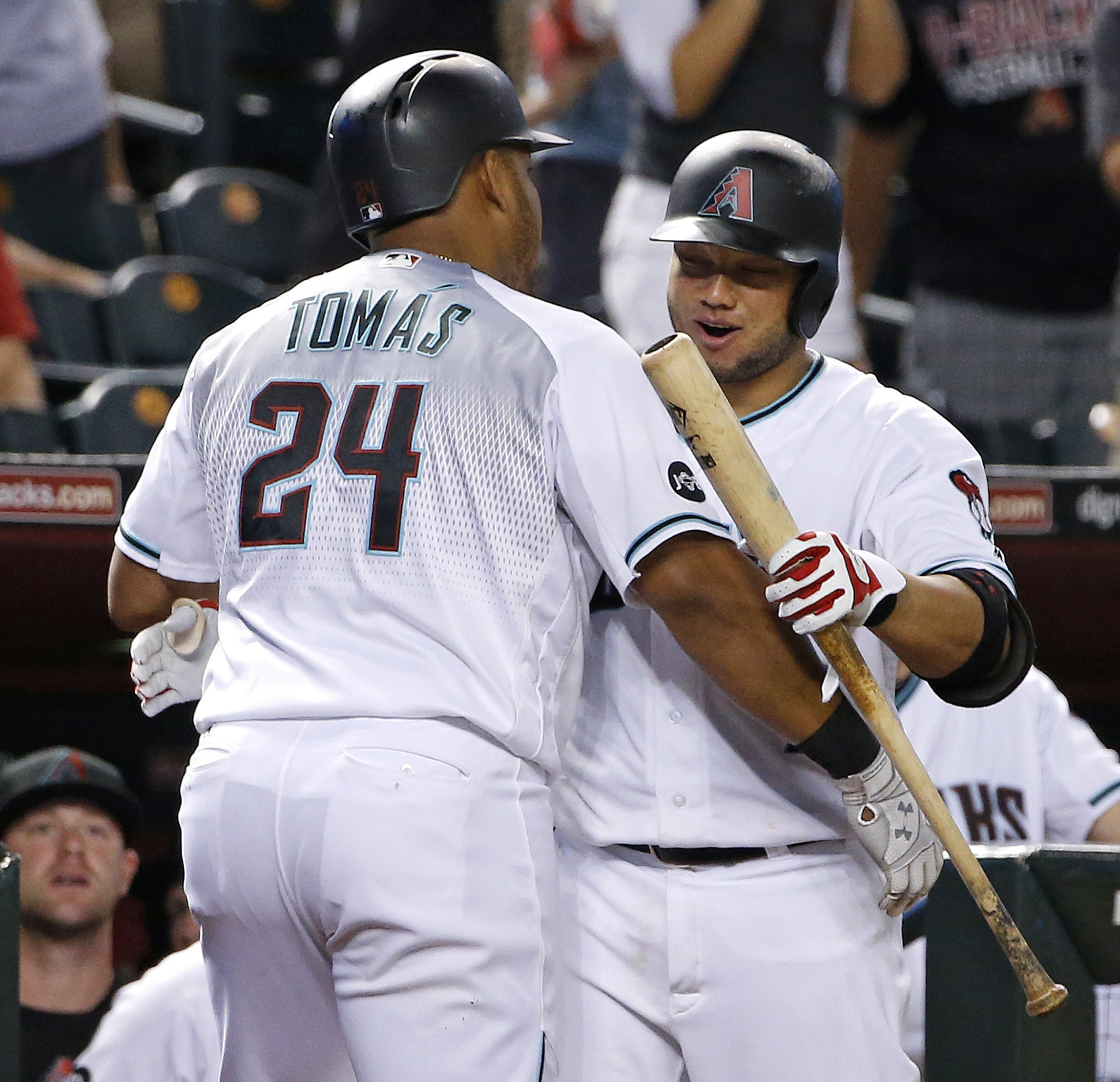 Arizona Diamondbacks' Yasmany Tomas (24) celebrates his home run against the Milwaukee Brewers with Welington Castillo, right, during the fourth inning of a baseball game Friday, Aug. 5, 2016, in Phoenix. Tomas had another home run in the second inning. (