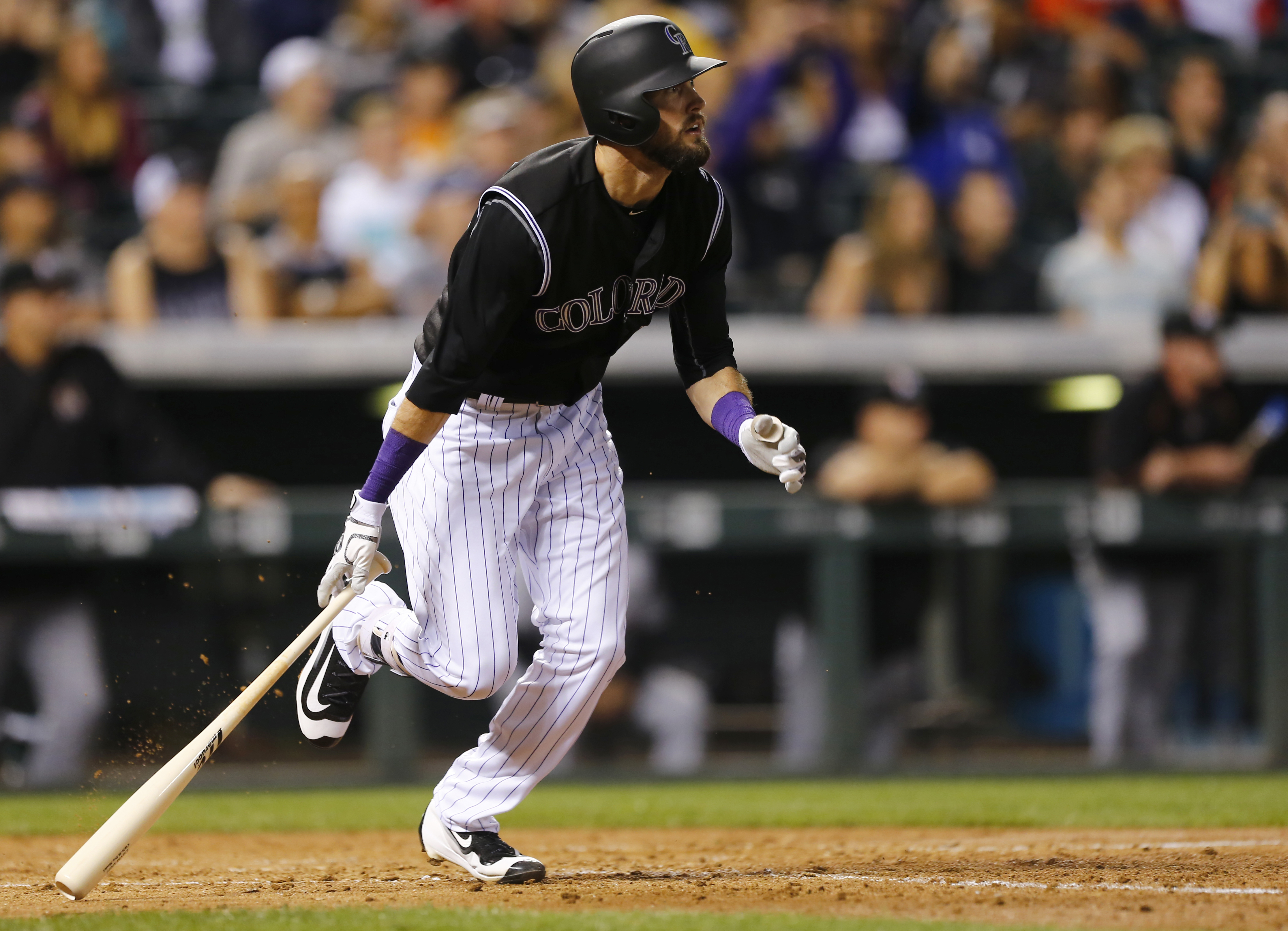 Colorado Rockies' David Dahl watches the flight of an RBI double ball hit against the Miami Marlins inning of a baseball game Friday, Aug. 5, 2016, in Denver. (AP Photo/Jack Dempsey)