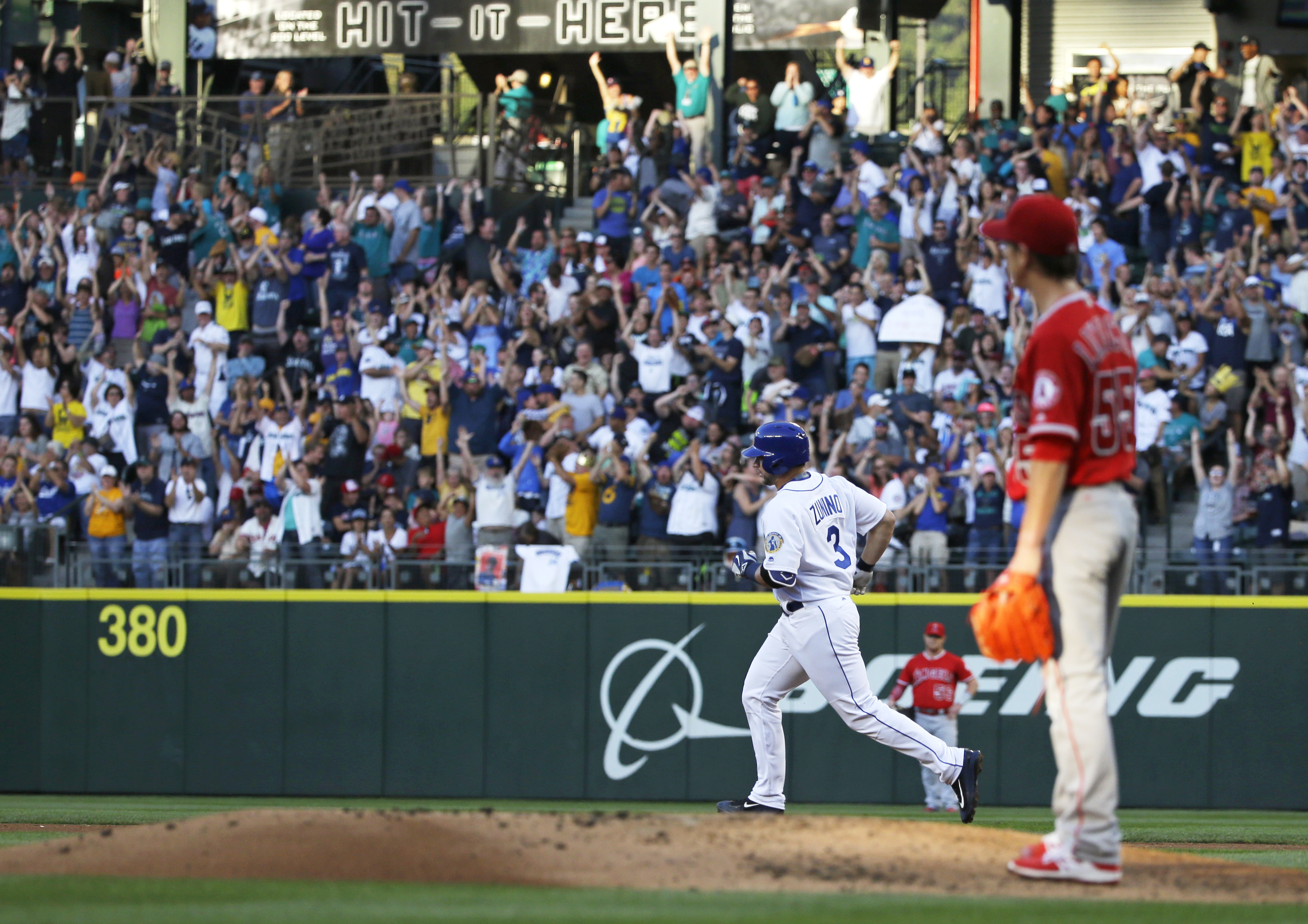 Los Angeles Angels starting pitcher Tim Lincecum, right, watches as Seattle Mariners' Mike Zunino (3) rounds the bases after Zunino hit a three-run home run to score Adam Lind and Nelson Cruz during the first inning of a baseball game, Friday, Aug. 5, 201