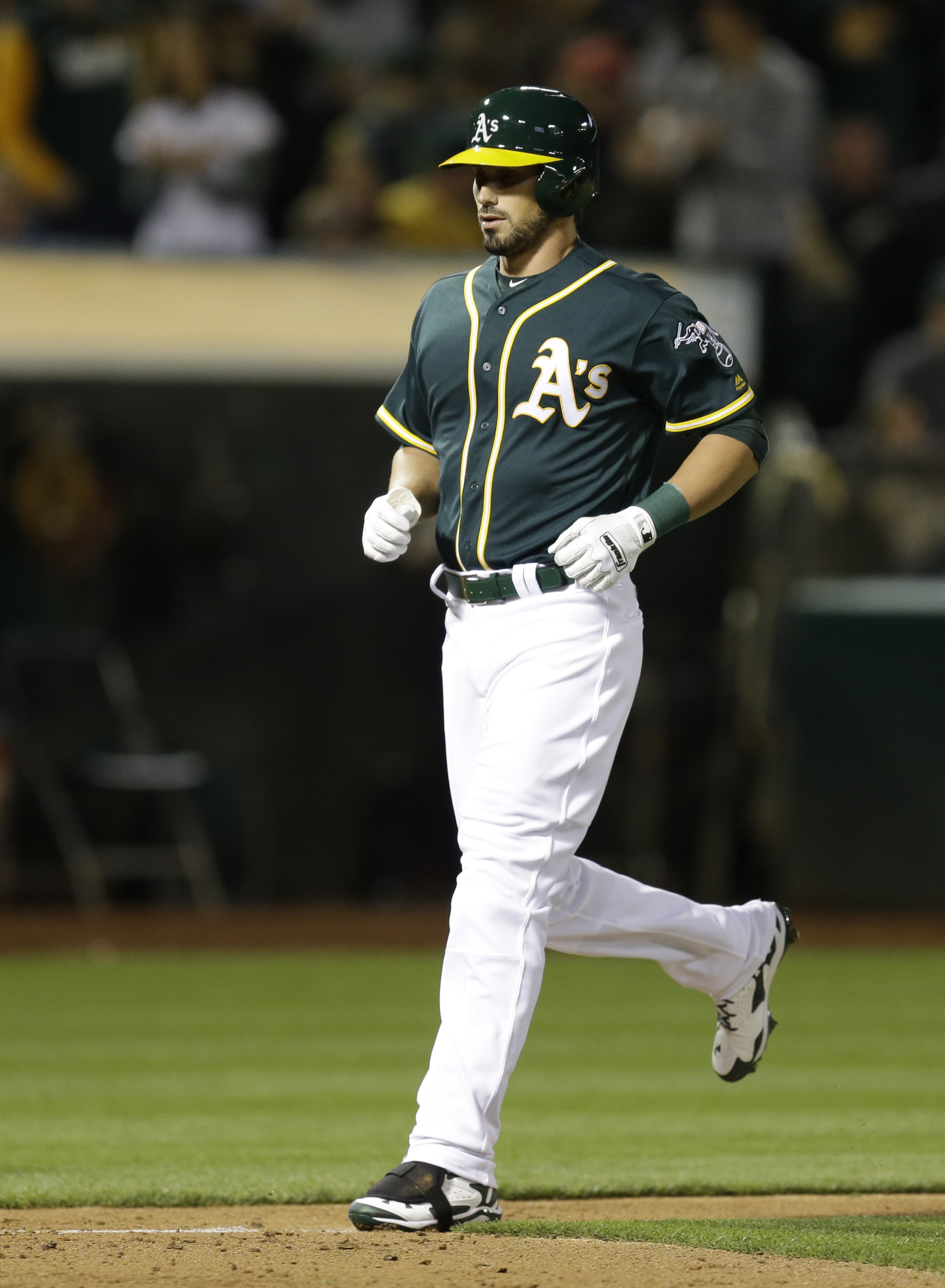 Oakland Athletics' Brett Eibner runs the bases after hitting a home run off Chicago Cubs' Jon Lester during the sixth inning of a baseball game Friday, Aug. 5, 2016, in Oakland, Calif. (AP Photo/Ben Margot)