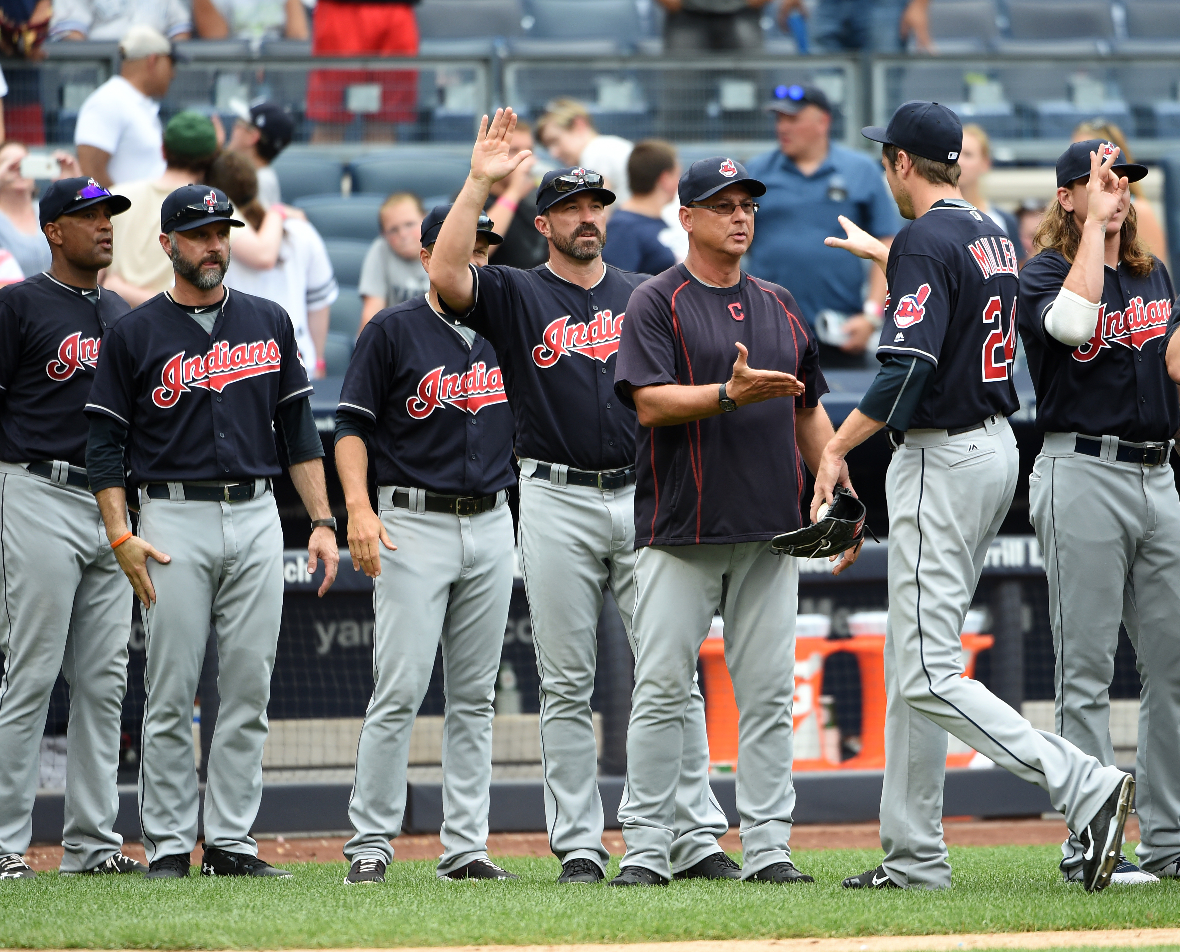 Cleveland Indians relief pitcher Andrew Miller (24) is congratulated by manager Terry Francona, third from right, and teammates after the Indians beat the New York Yankees 5-2 in a baseball game, Saturday, Aug. 6, 2016, in New York. (AP Photo/Kathy Kmonic