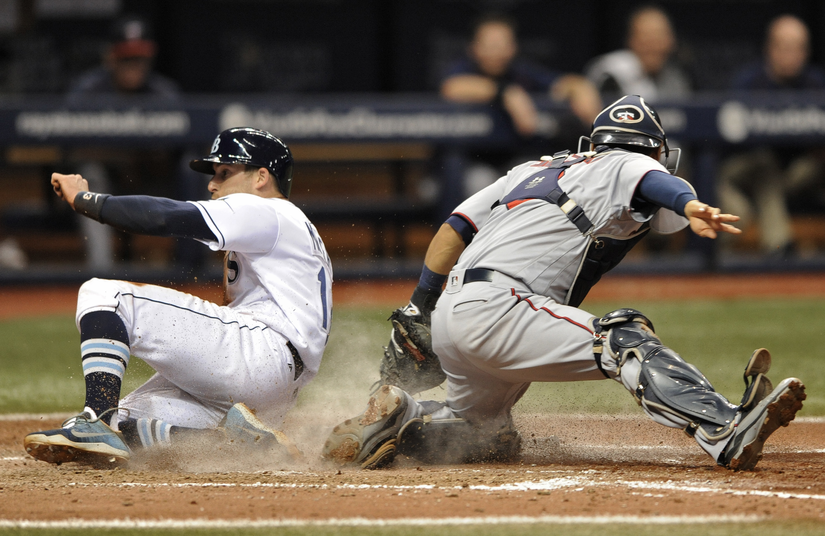 Tampa Bay Rays' Brad Miller, left, beats the tag from Minnesota Twins catcher Kurt Suzuki, right, to score on Nick Franklin's fielder's choice to shortstop during the sixth inning of a baseball game Saturday, Aug. 6, 2016, in St. Petersburg, Fla. (AP Phot