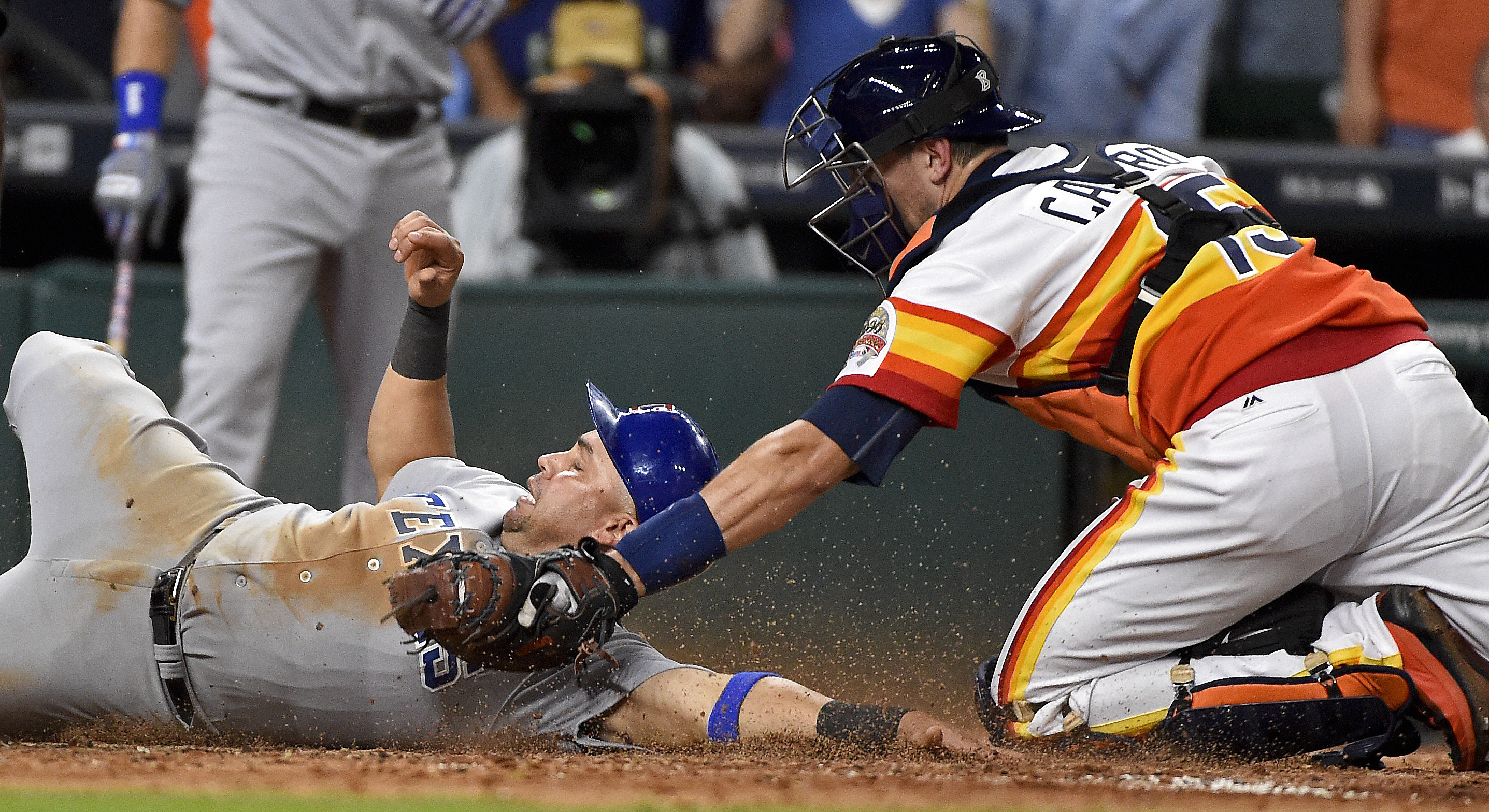 Texas Rangers' Carlos Beltran, left, is tagged out at home by Houston Astros' catcher Jason Castro in the seventh inning of a baseball game, Saturday, Aug. 6, 2016, in Houston. (AP Photo/Eric Christian Smith)